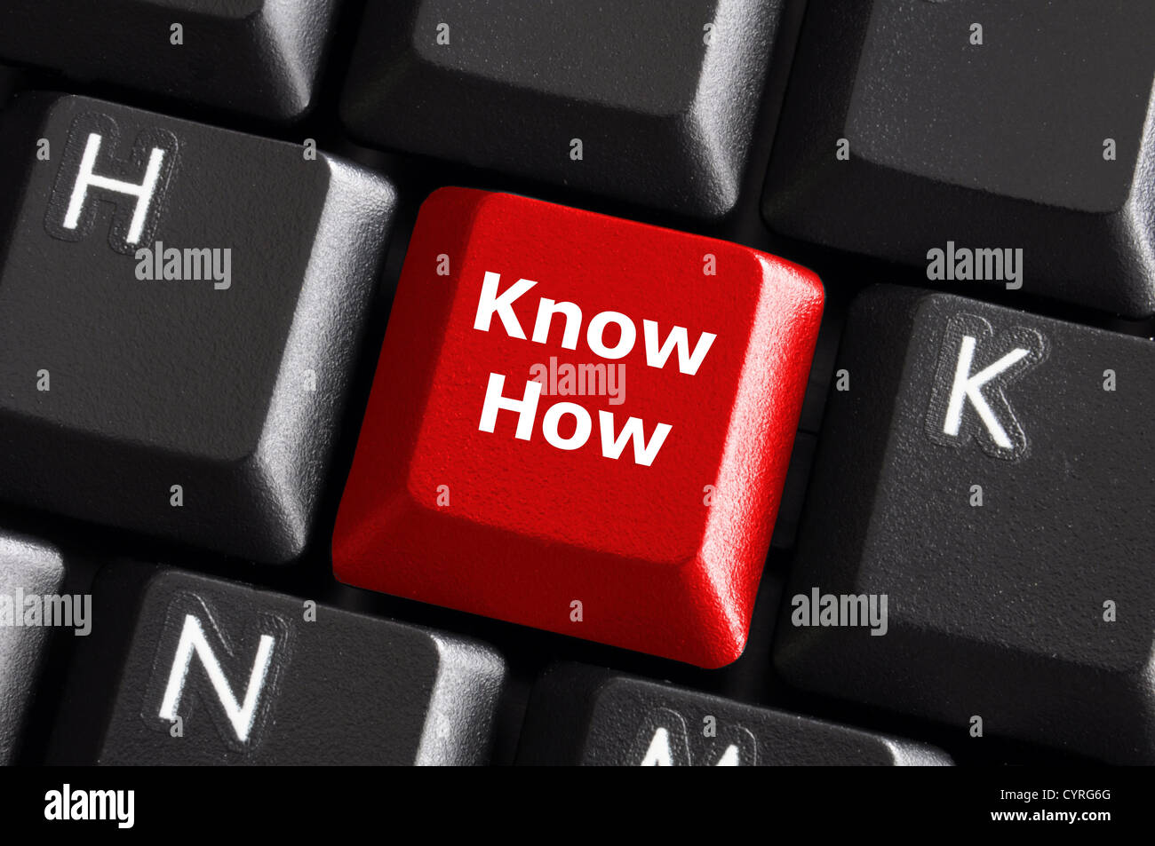 know how knowledge or education concept with red button on computer keyboard - Stock Image