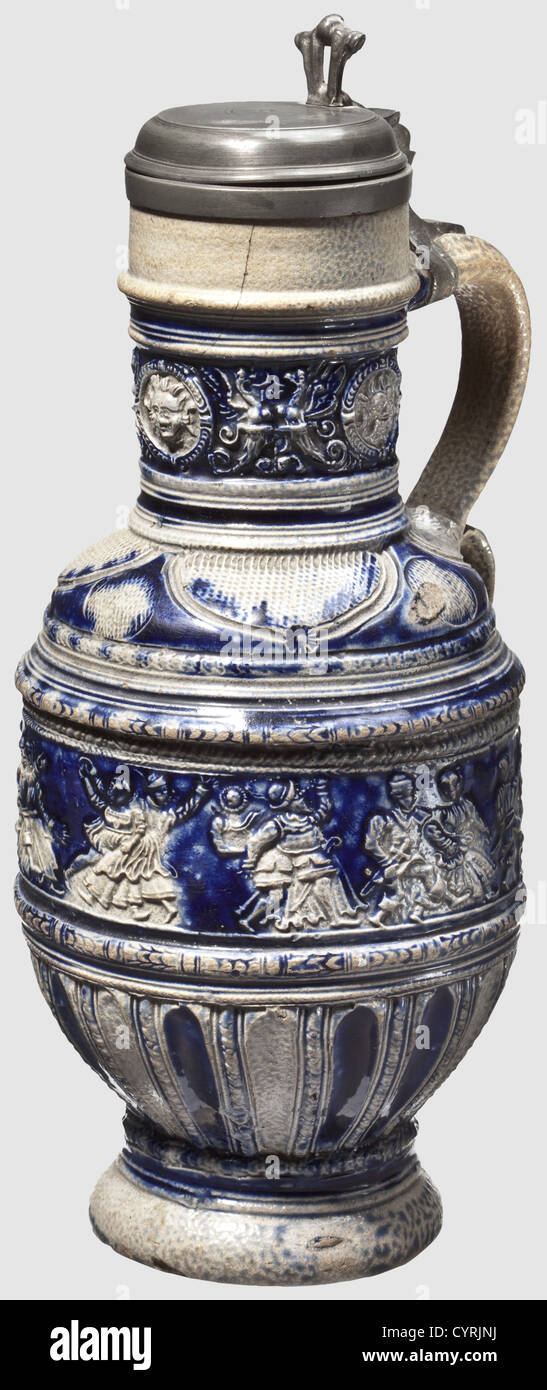 A 'Peasant Dance' jug, Raeren, circa 1580 Grey stonewear with blue engobing in places. A round belly jug - Stock Image