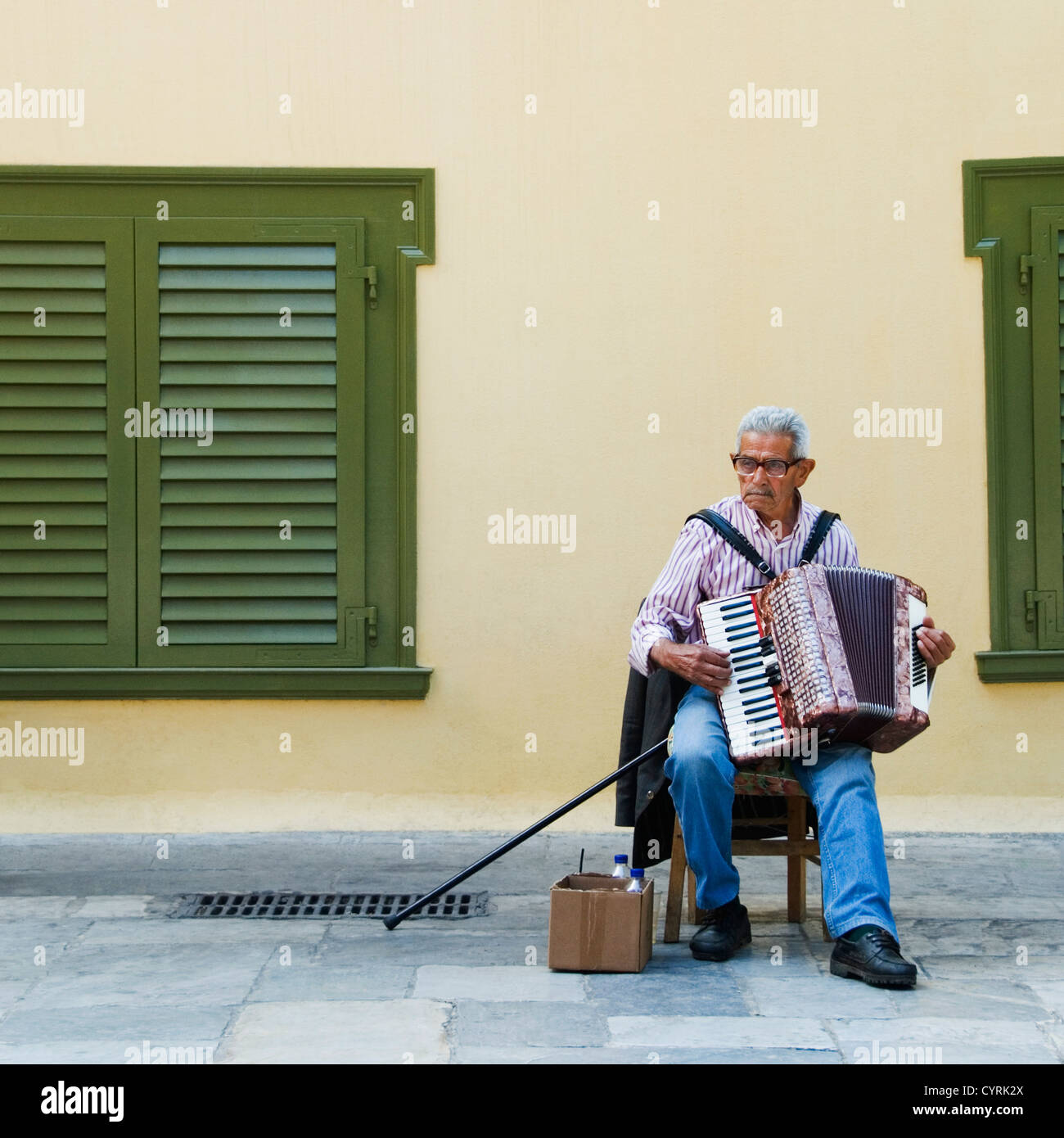 Man playing an accordion, Athens, Greece - Stock Image