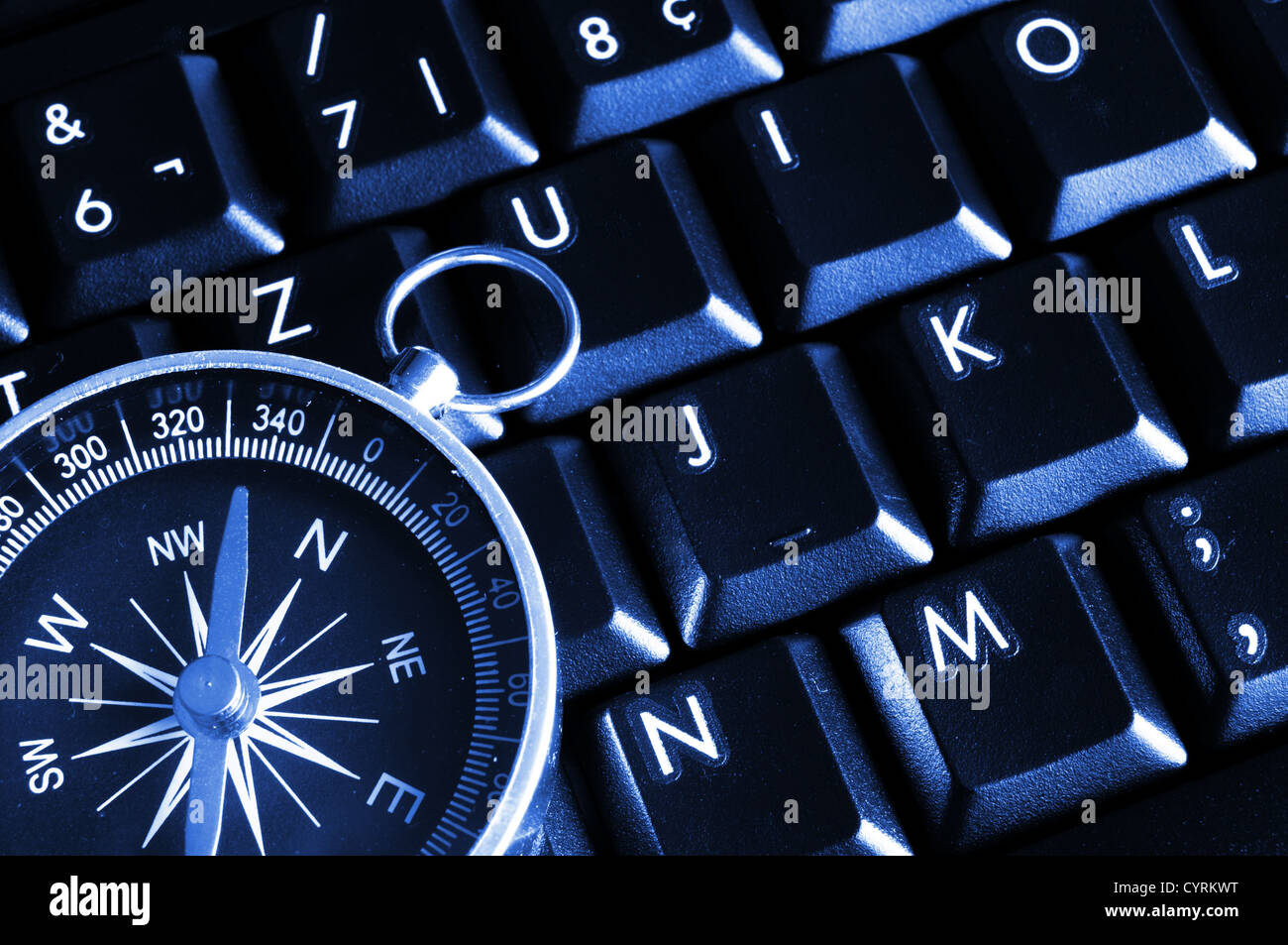 computer keyboard and compass showing internet navigation concept Stock Photo