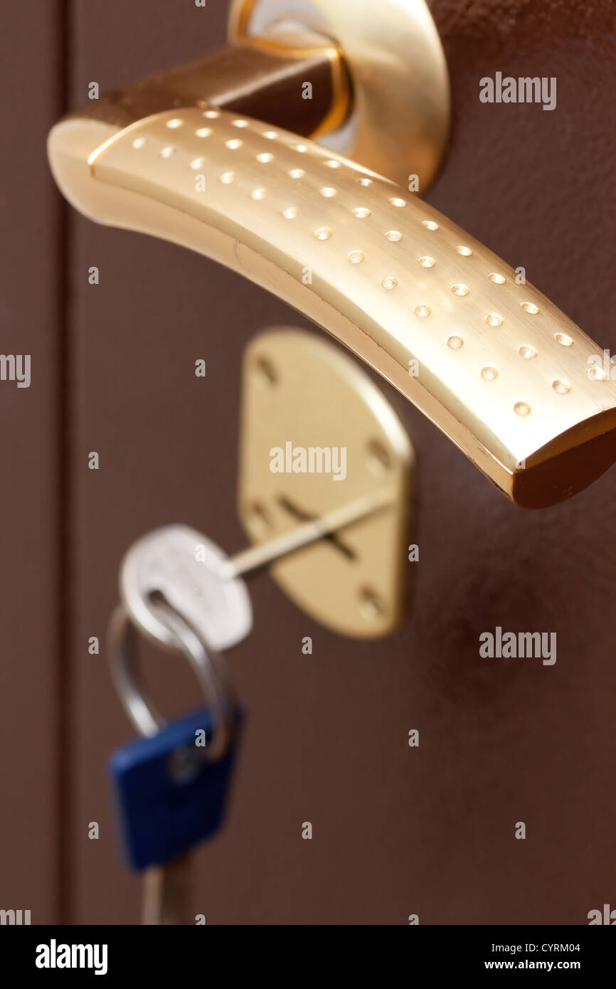 Door handle and secure lock in new apartment - Stock Image