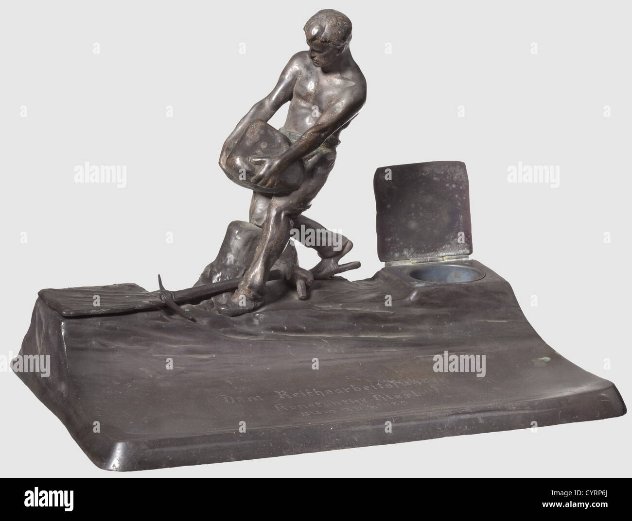 Konstantin Hierl, a presentation writing table set made of blackened bronze Modelled figure of a quarryman with - Stock Image