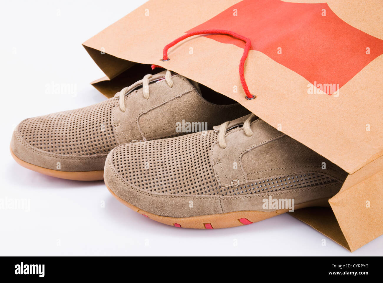 Close-up of a pair of shoes in a shopping bag - Stock Image
