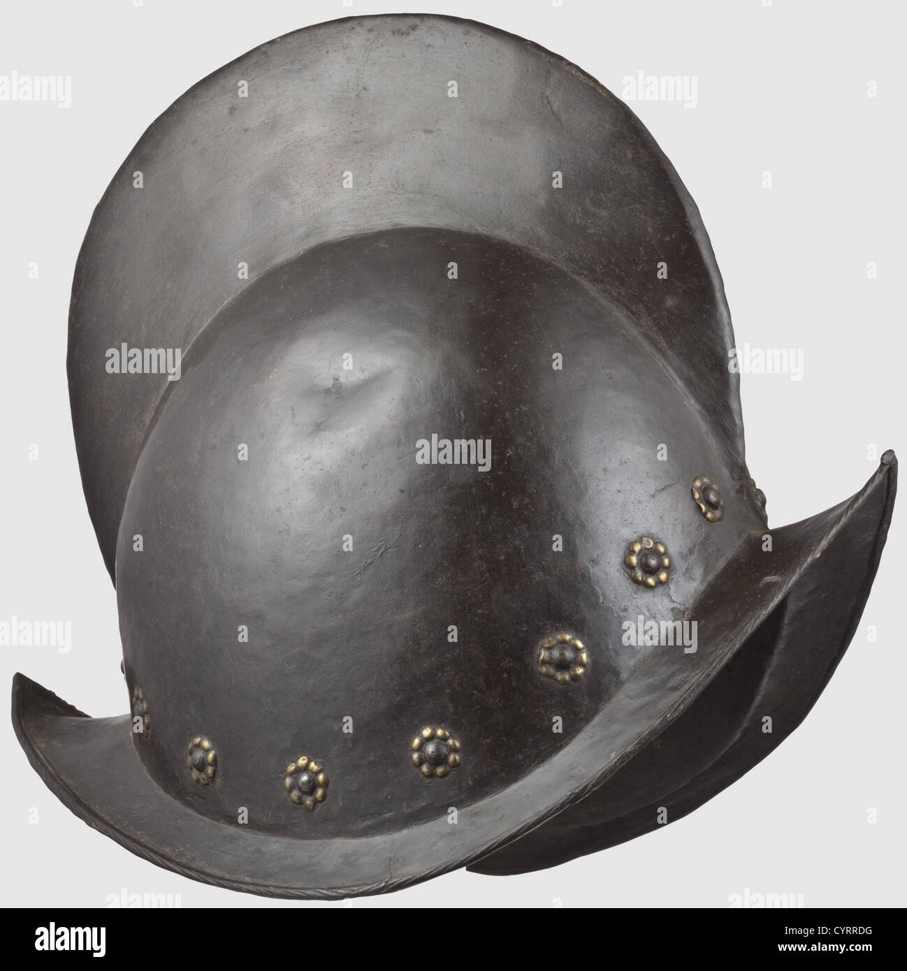 A blackened Nuremberg morion, circa 1600 One-piece skull with the original blackening, with visible hammer pattern - Stock Image