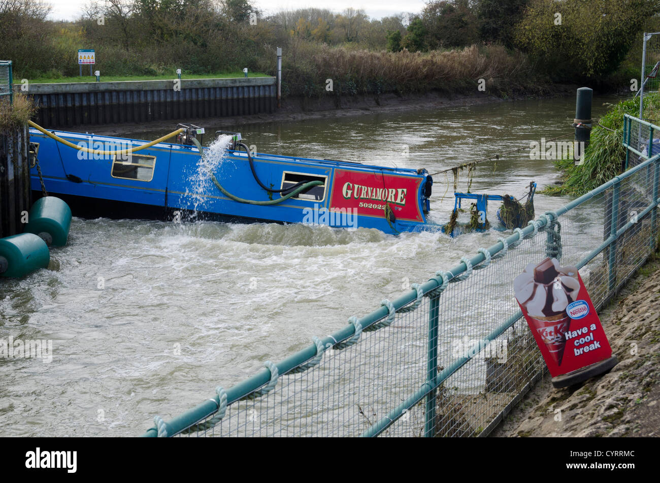 Recovery operation to rescue a sunken narrowboat - Stock Image