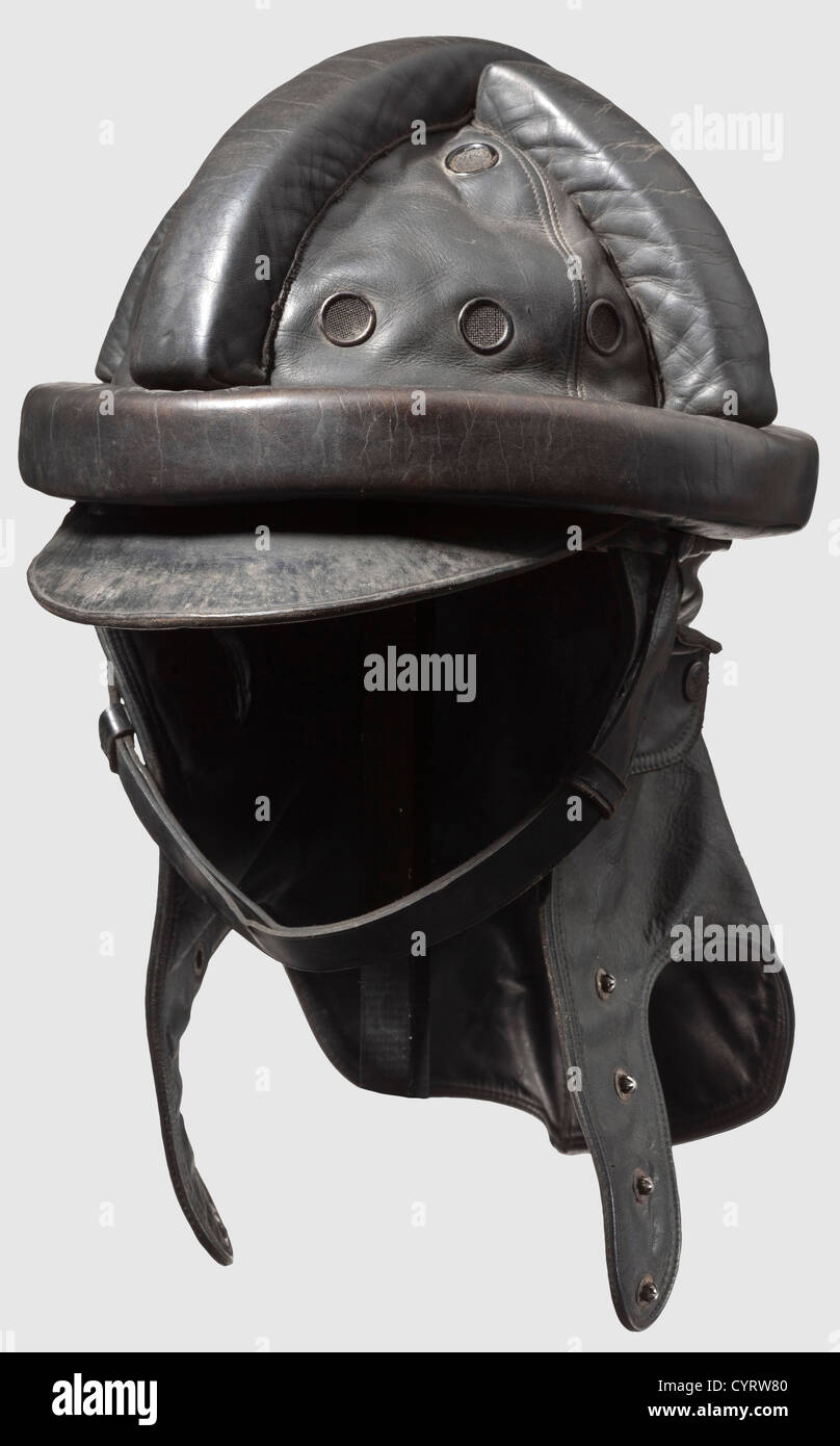 A protective helmet for glider pilots, leather helmet for towplane crews Black leather skull with cross-shaped combs - Stock Image