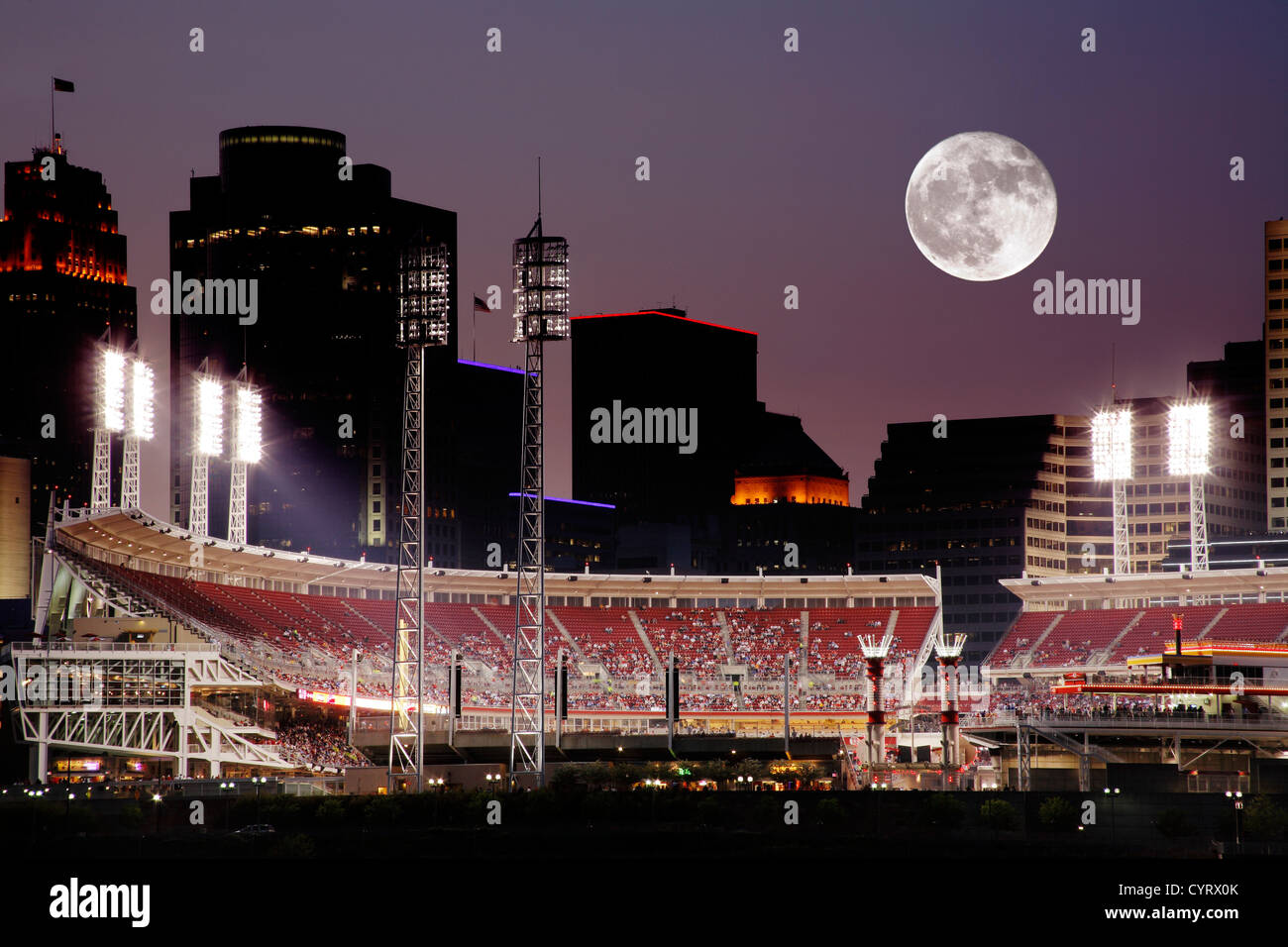 Moonrise Over Cincinnati Ohio After Sunset, Baseball Night In The Queen City On The Ohio River, USA - Stock Image