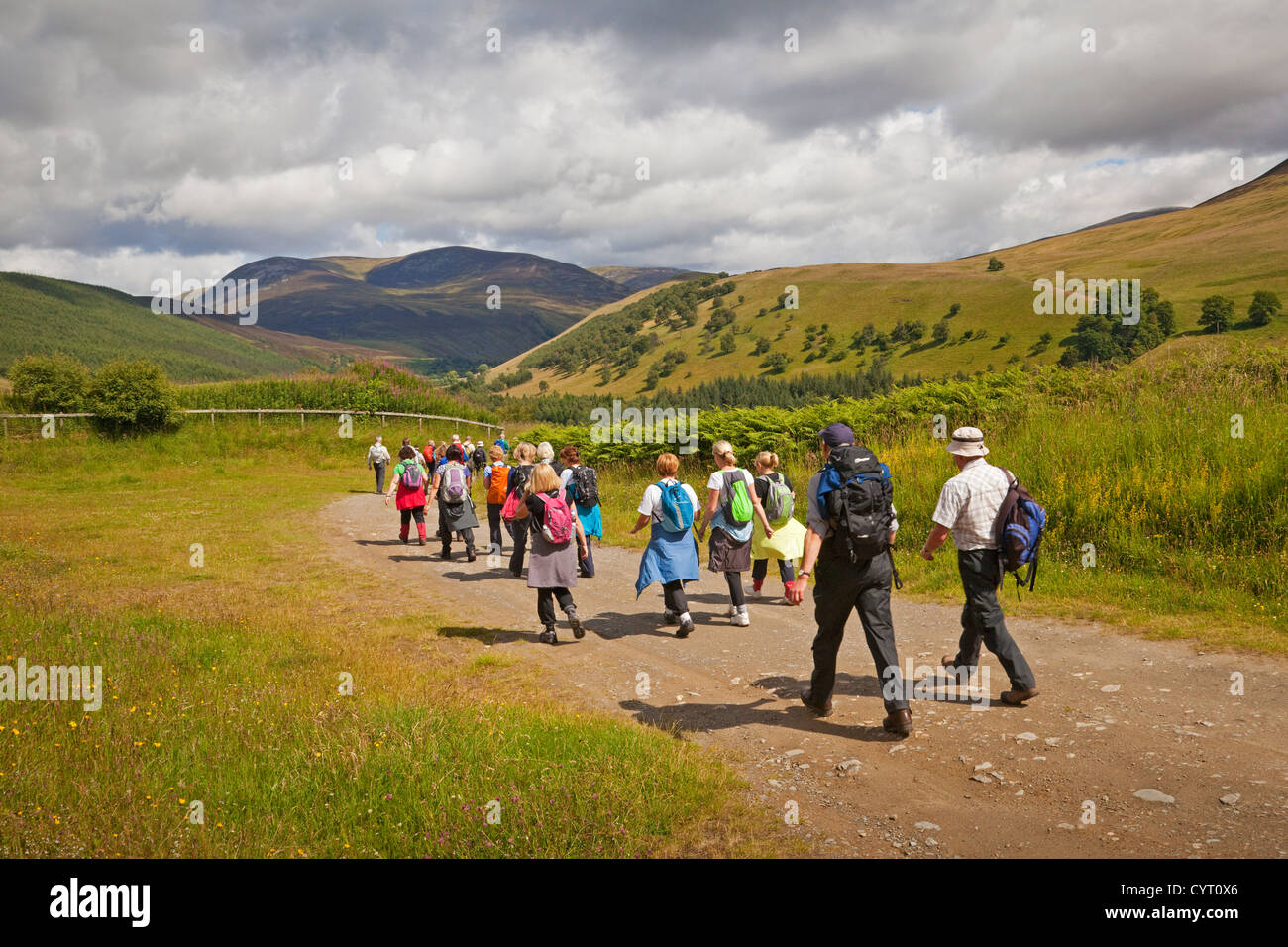 A Rambling Club in Glen Tilt, near Blair Atholl. Beinn a'Ghlo is in the background. - Stock Image