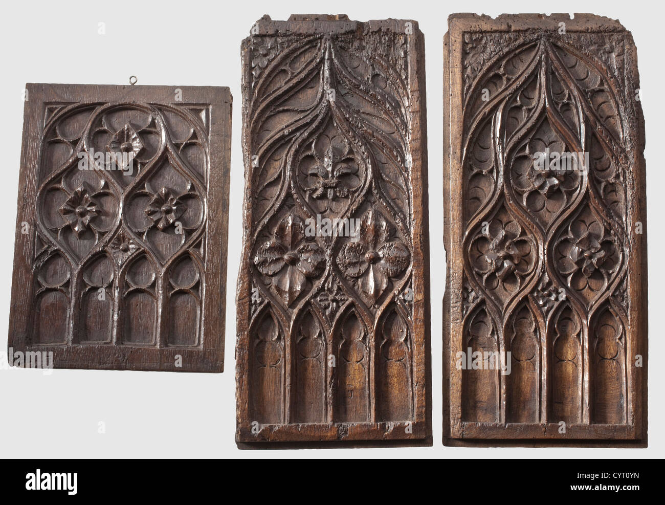 Three German or French Gothic Panels, around 1500 Carved oak with a beautiful aged patina. One pair of tall rectangular - Stock Image