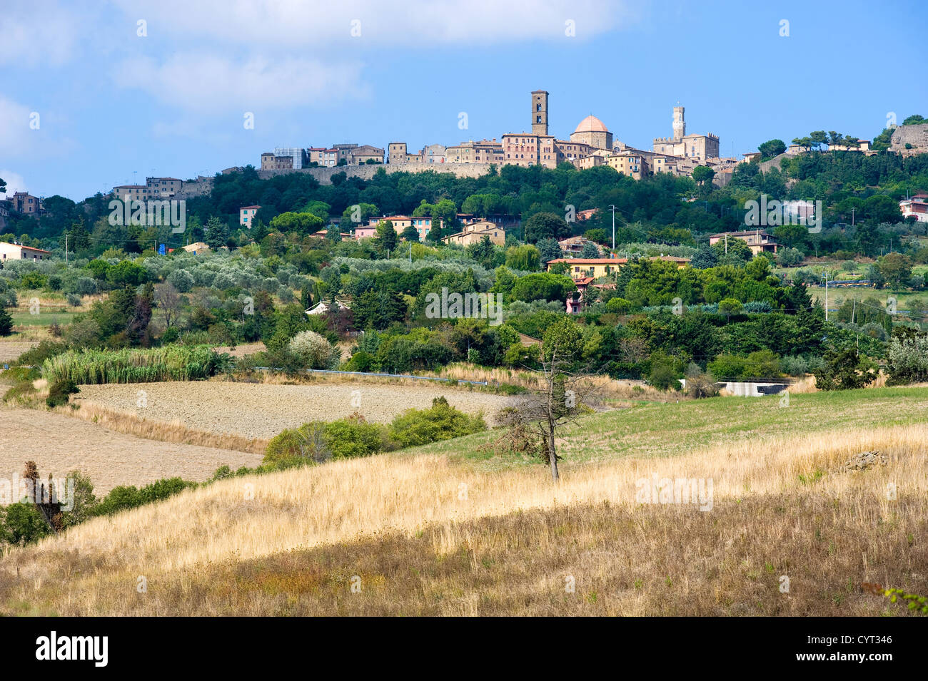 The city of Volterra in the landscape of Tuscany in Italy. - Stock Image