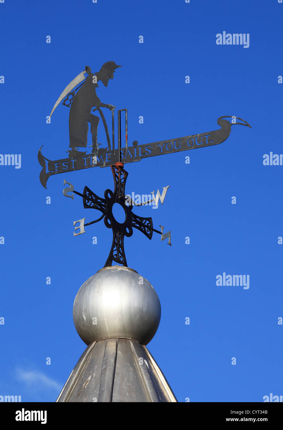 Weather vane above bandstand 'Lest Time Bails You Out'  Durham north east England UK - Stock Image