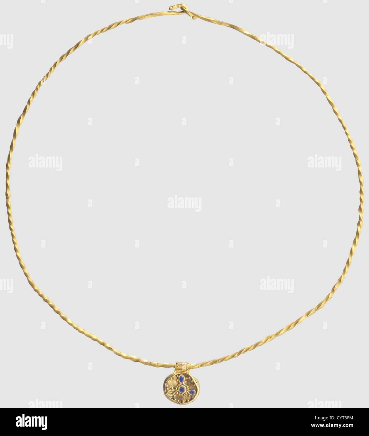 A Roman gold torque with pendant, 2nd/3rd century AD. Narrow twisted gold loop with a hook latch. The hollow pendant - Stock Image