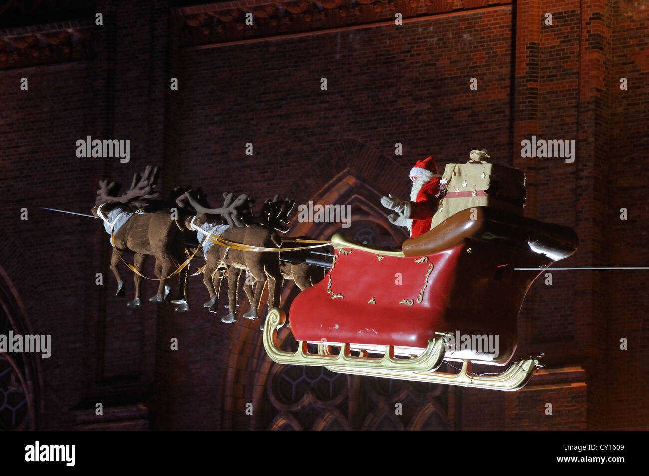 Santa Claus in his sleigh flying on Christmas market at Opernpalais in front of Friedrichwerdersche Kirche, Berlin, - Stock Image