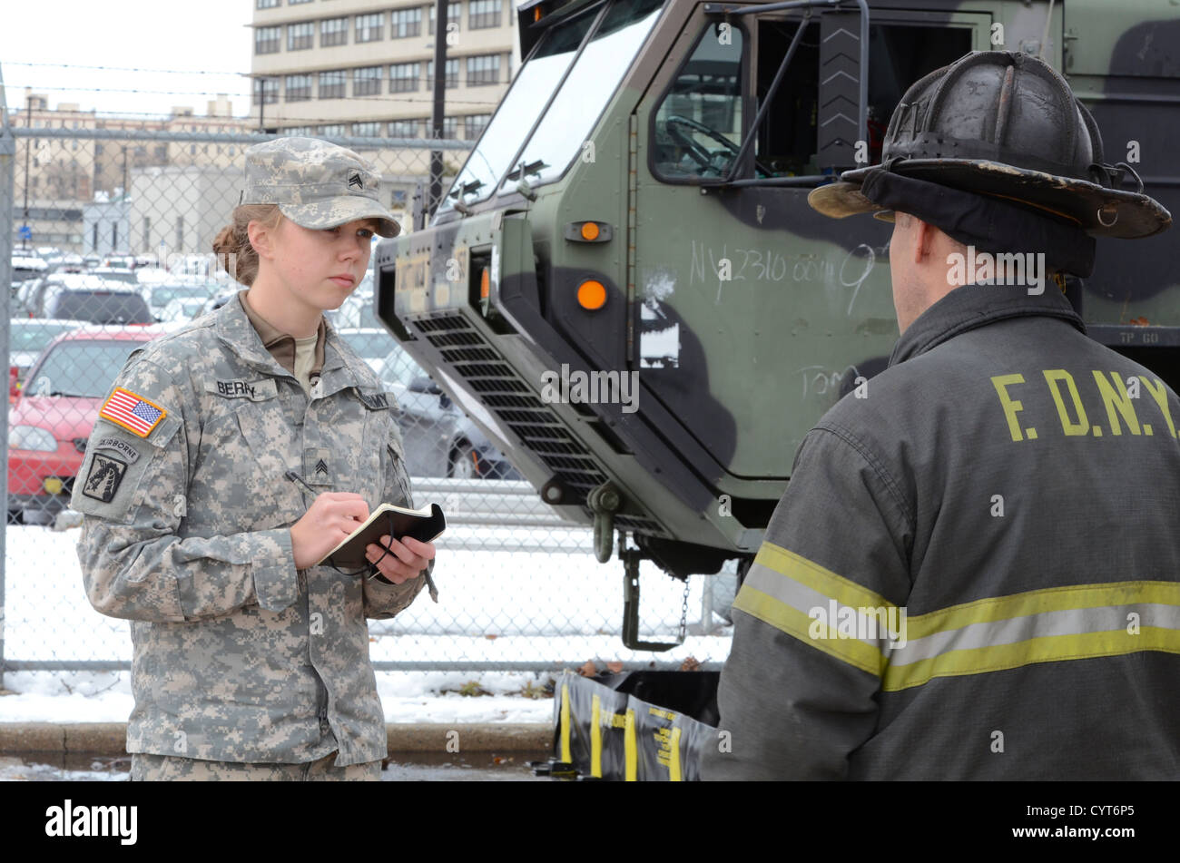 U.S. Army Sgt. Meghan Berry interviews a firefighter of the New York City Fire Department (F.D.N.Y.) on Fort Hamilton, - Stock Image