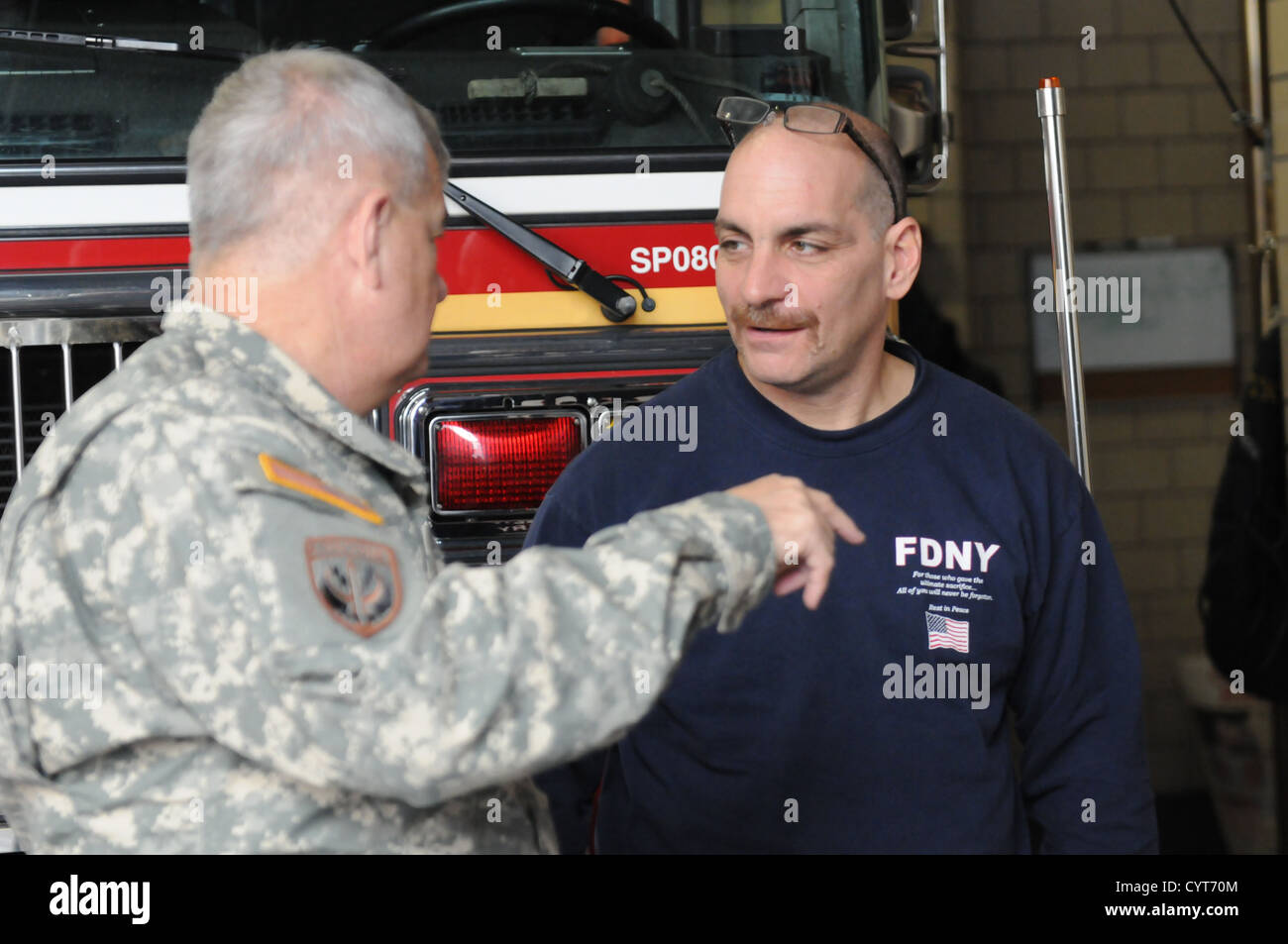 Capt. Louis Capezza, New York Fire Department, talks to U.S. Army Maj. Gen. Jeff W. Mathis III, commander, Joint - Stock Image