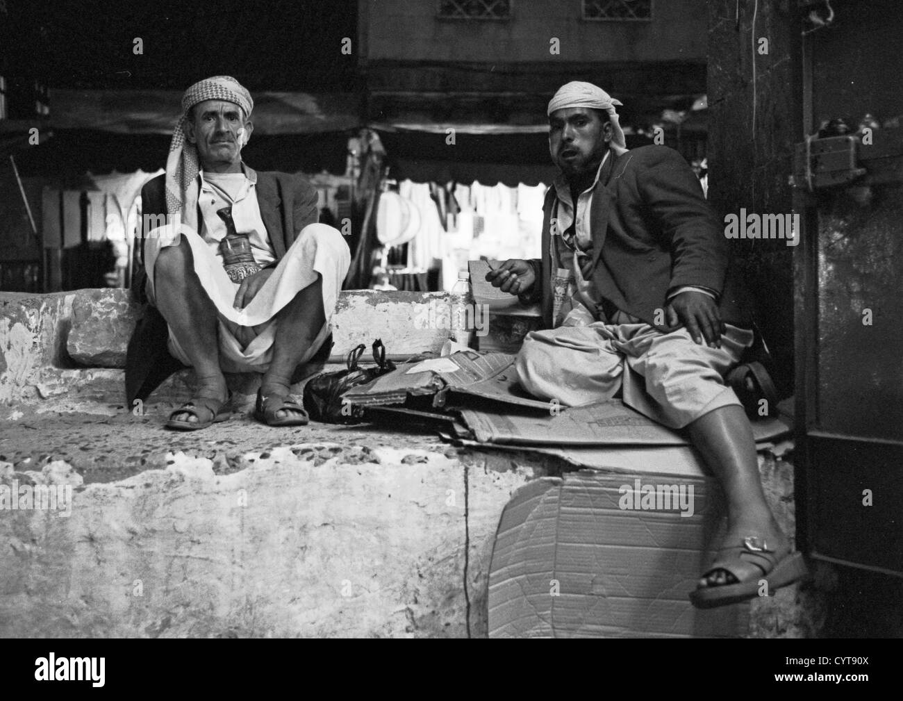 Two Men Chewing Qat While Relaxing, Black And White, Sanaa, Yemen - Stock Image