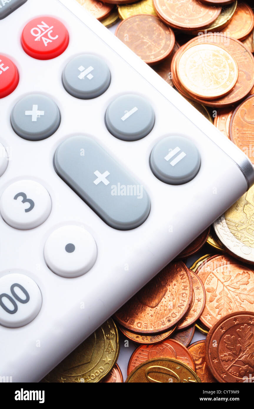 budget calculation or accounting concept with calculator and money - Stock Image