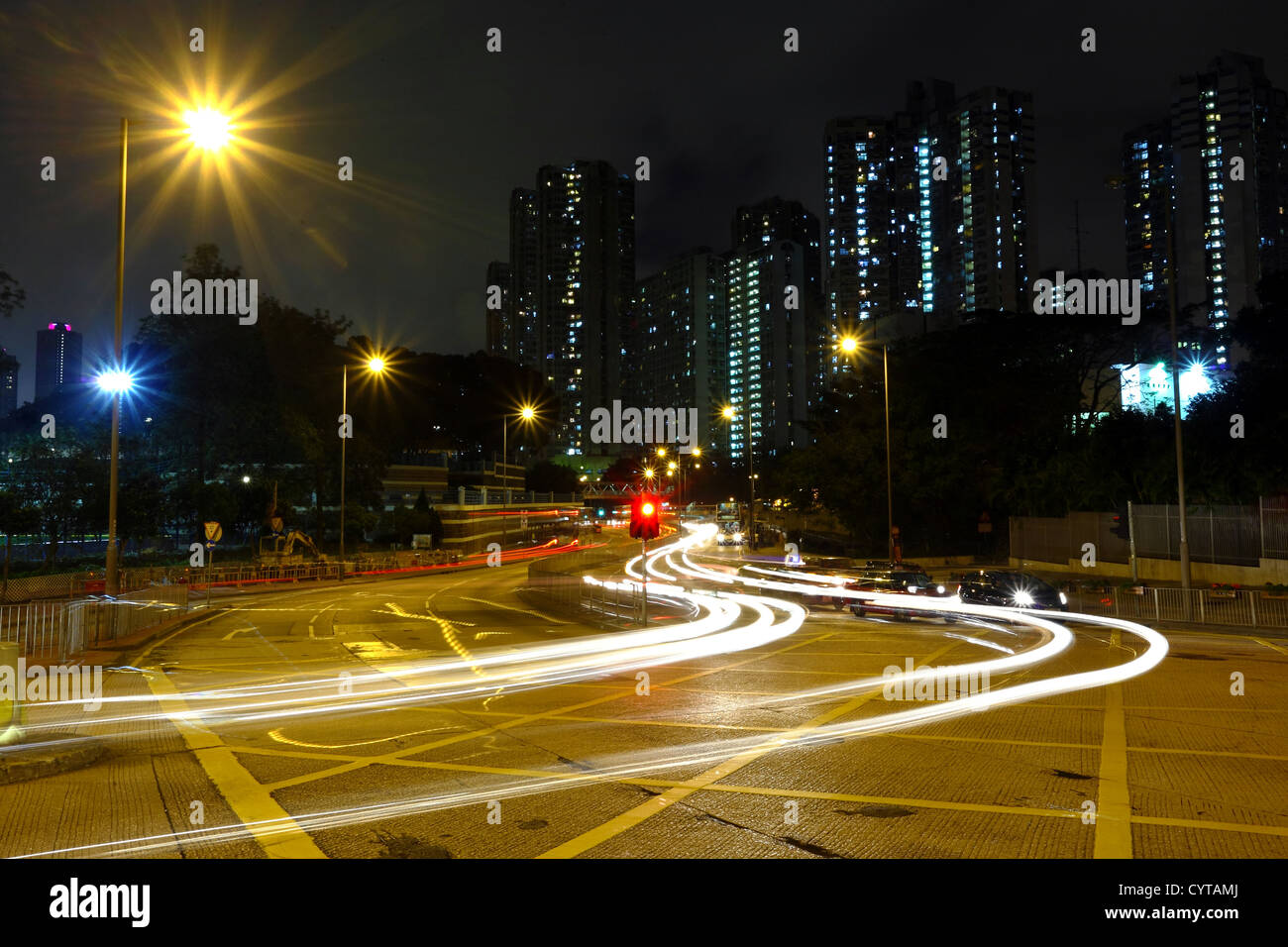 High traffic road with motion blurred automobile - Stock Image