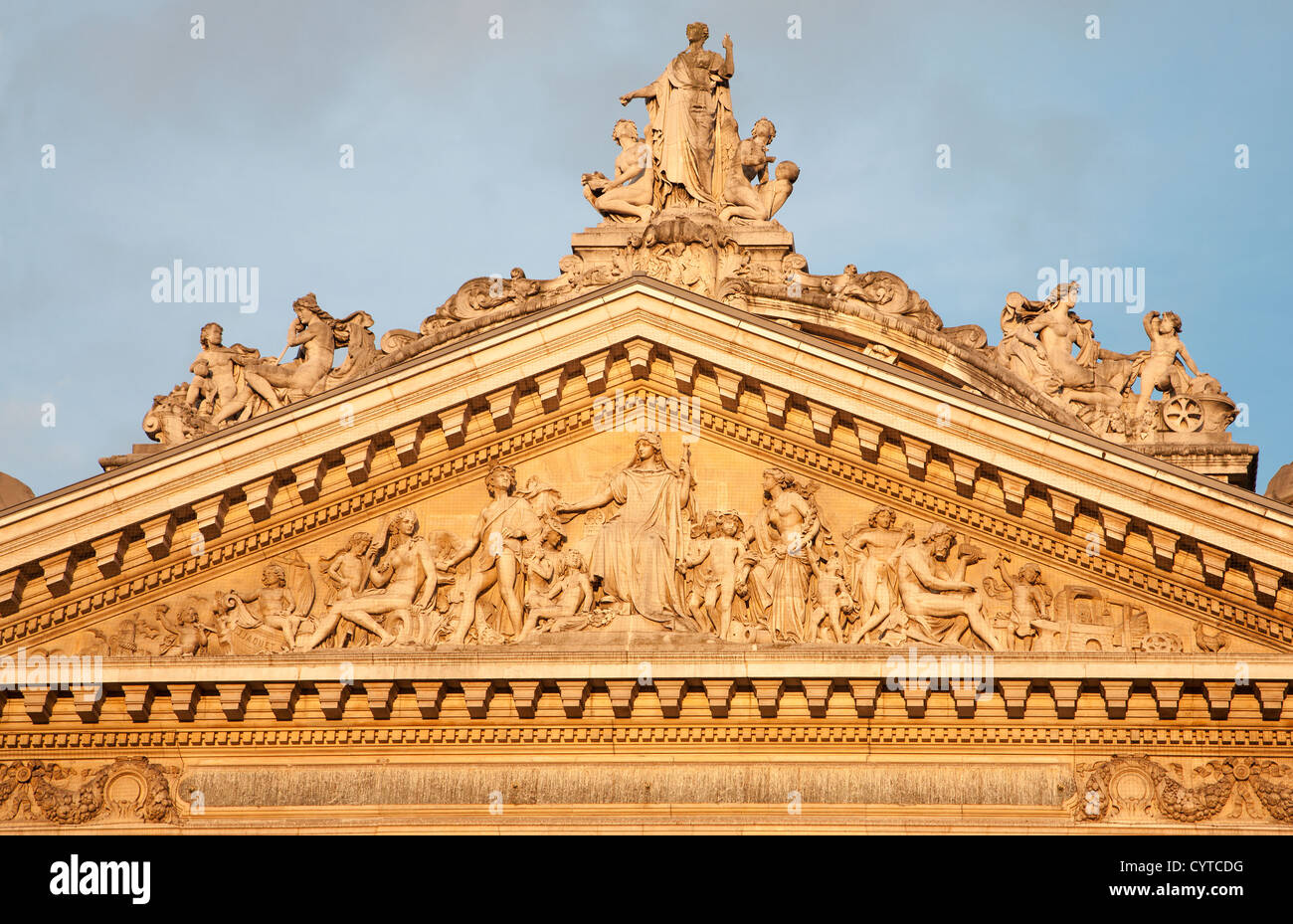 Brussels - Tympanum of the Stock Exchange building - Bourse in evening. - Stock Image