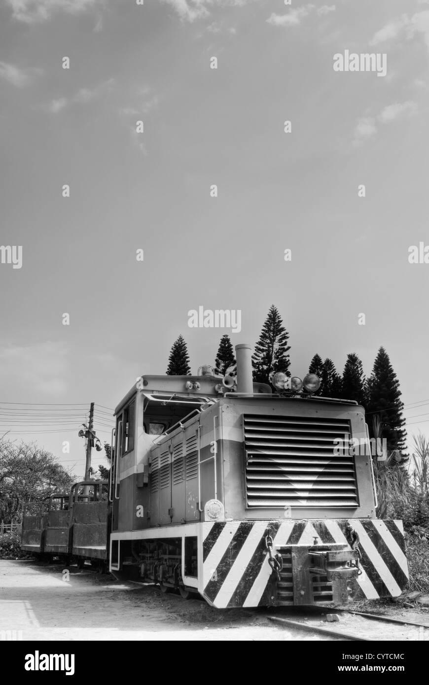 Locomotive of discard under sky in black and white tone. - Stock Image