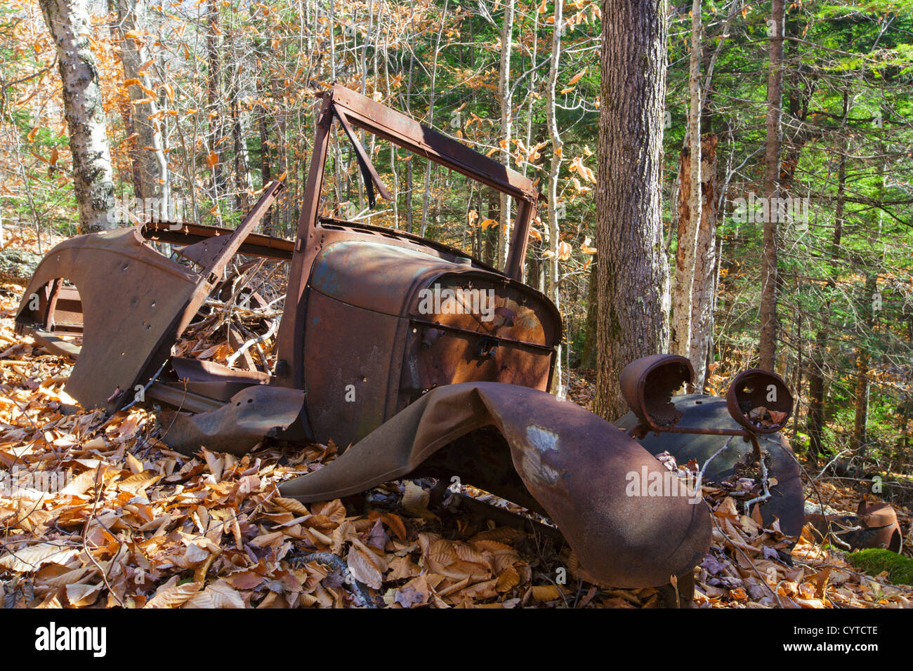 Rusted car in the Eastman Brook drainage of Thornton, New Hampshire USA Stock Photo