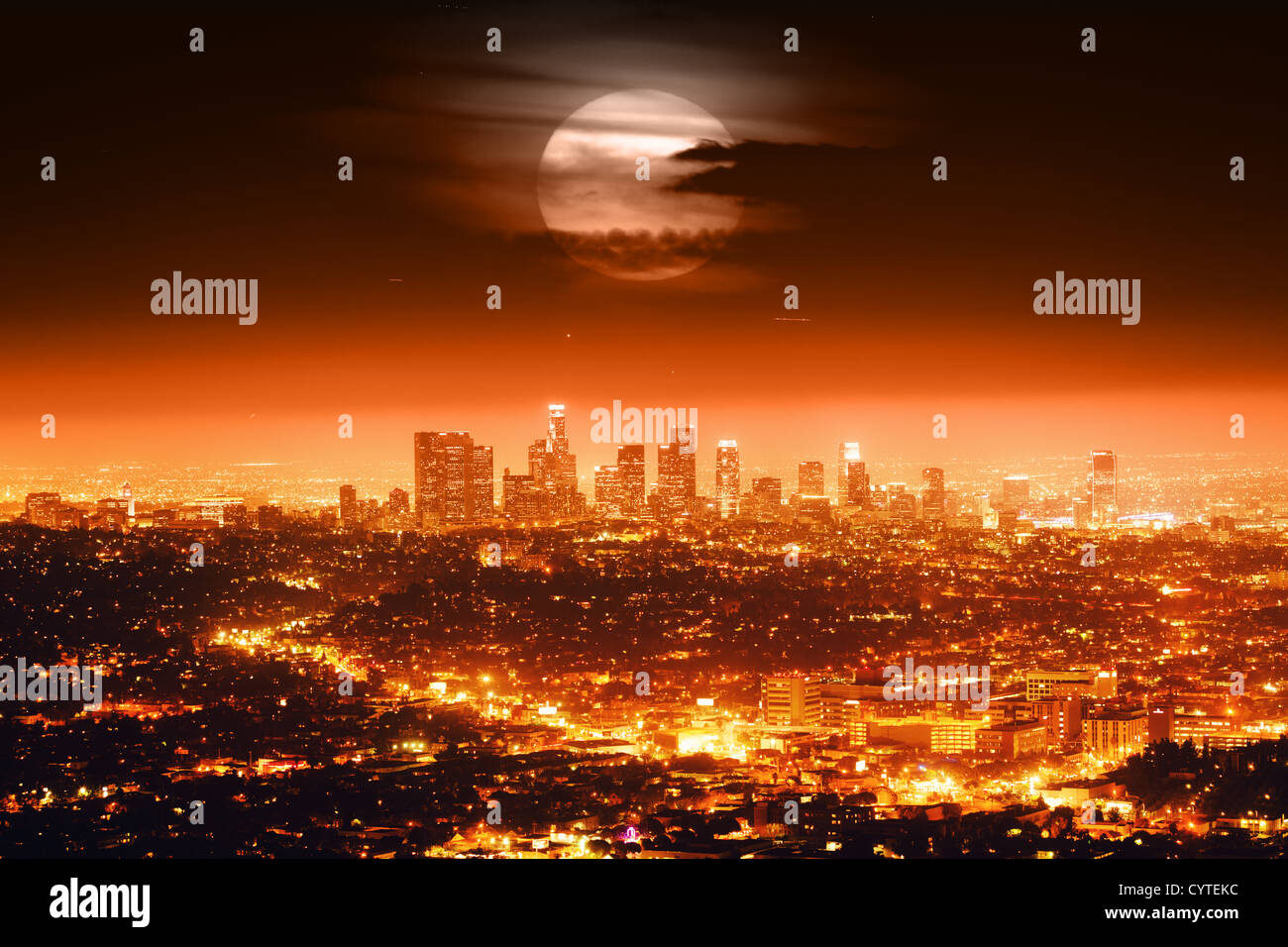 Dramatic full moon over Los Angeles skyline at night. - Stock Image