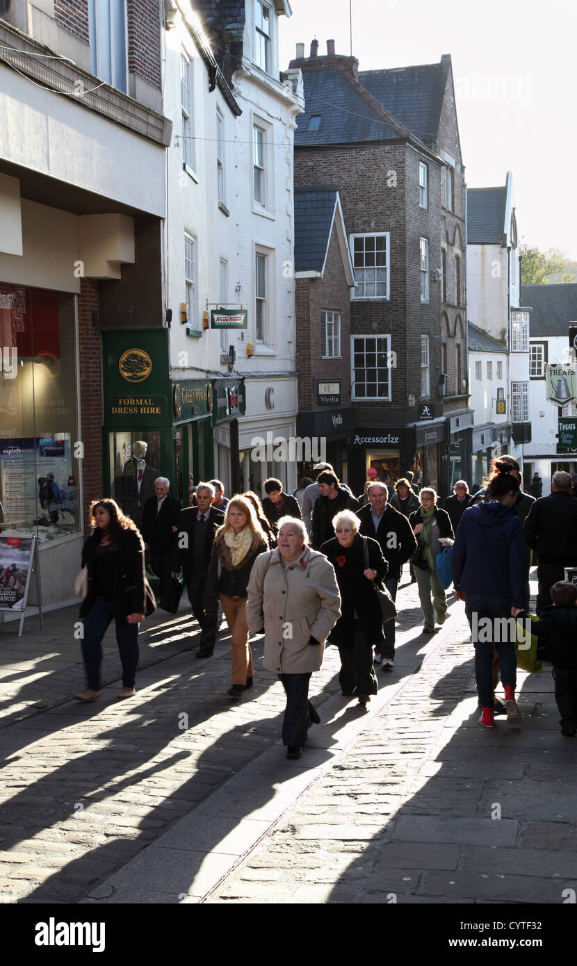 Shoppers walking up Silver St Durham City centre north east England UK - Stock Image