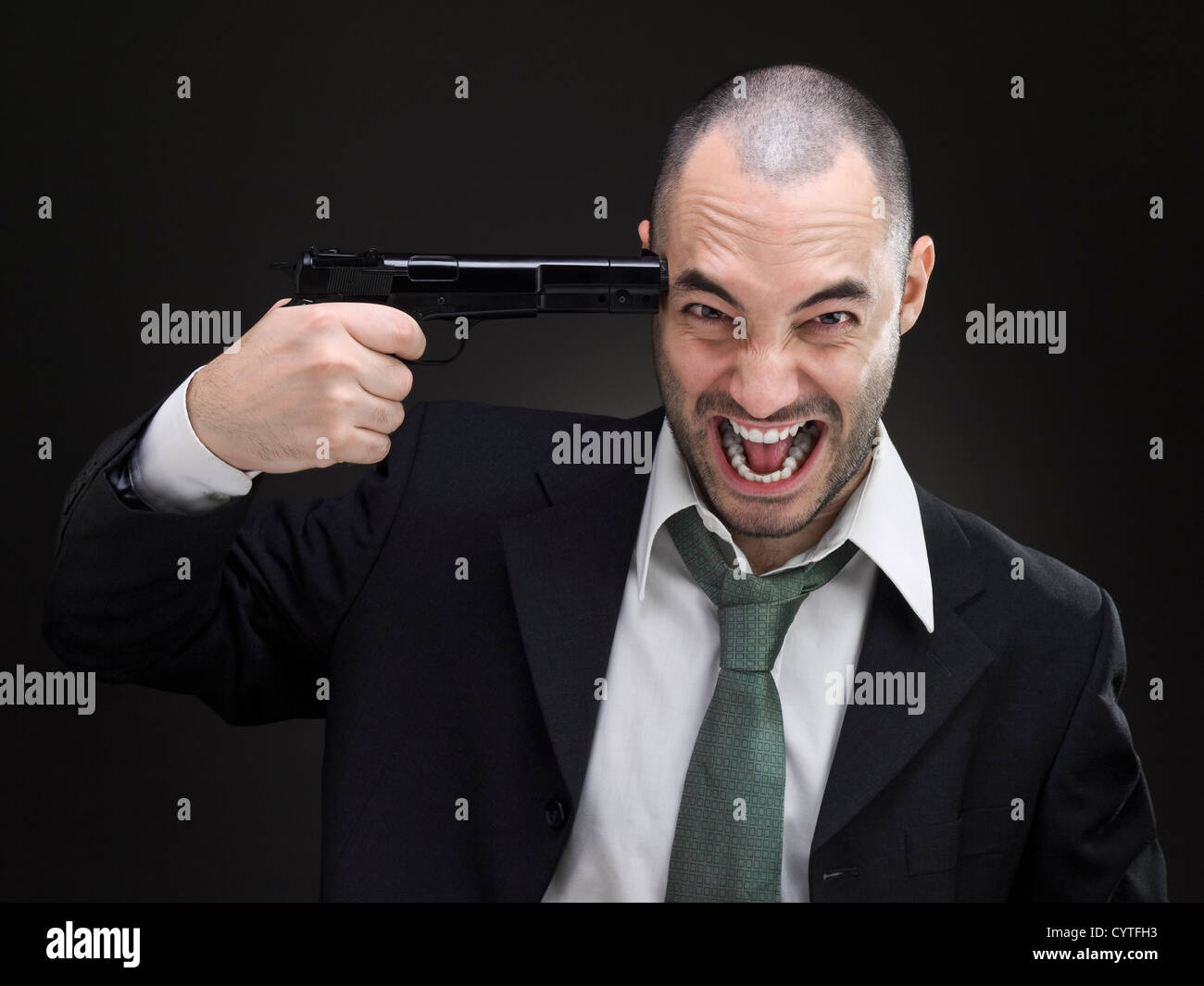 A desperate businessman attempts to commit suicide. - Stock Image