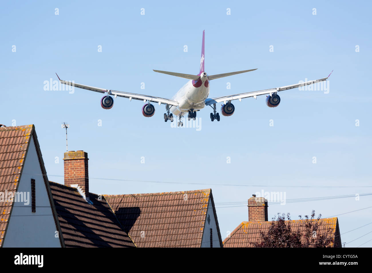 VIrgin Atlantic A340 approaches Heathrow on 9 September 2012. London Heathrow is the third busiest airport in the - Stock Image