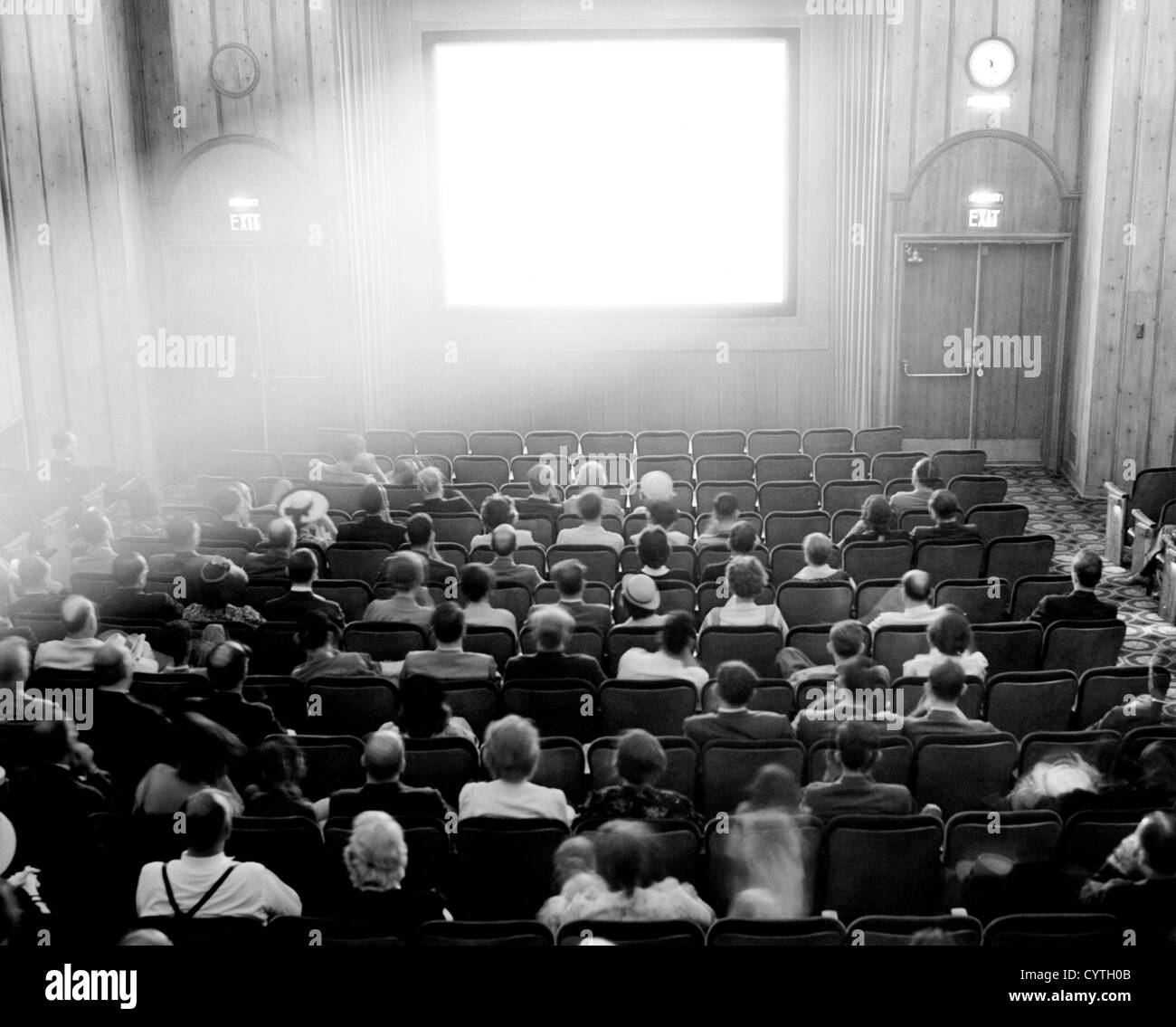 Couples in a theater preparing to watch a film - Stock Image