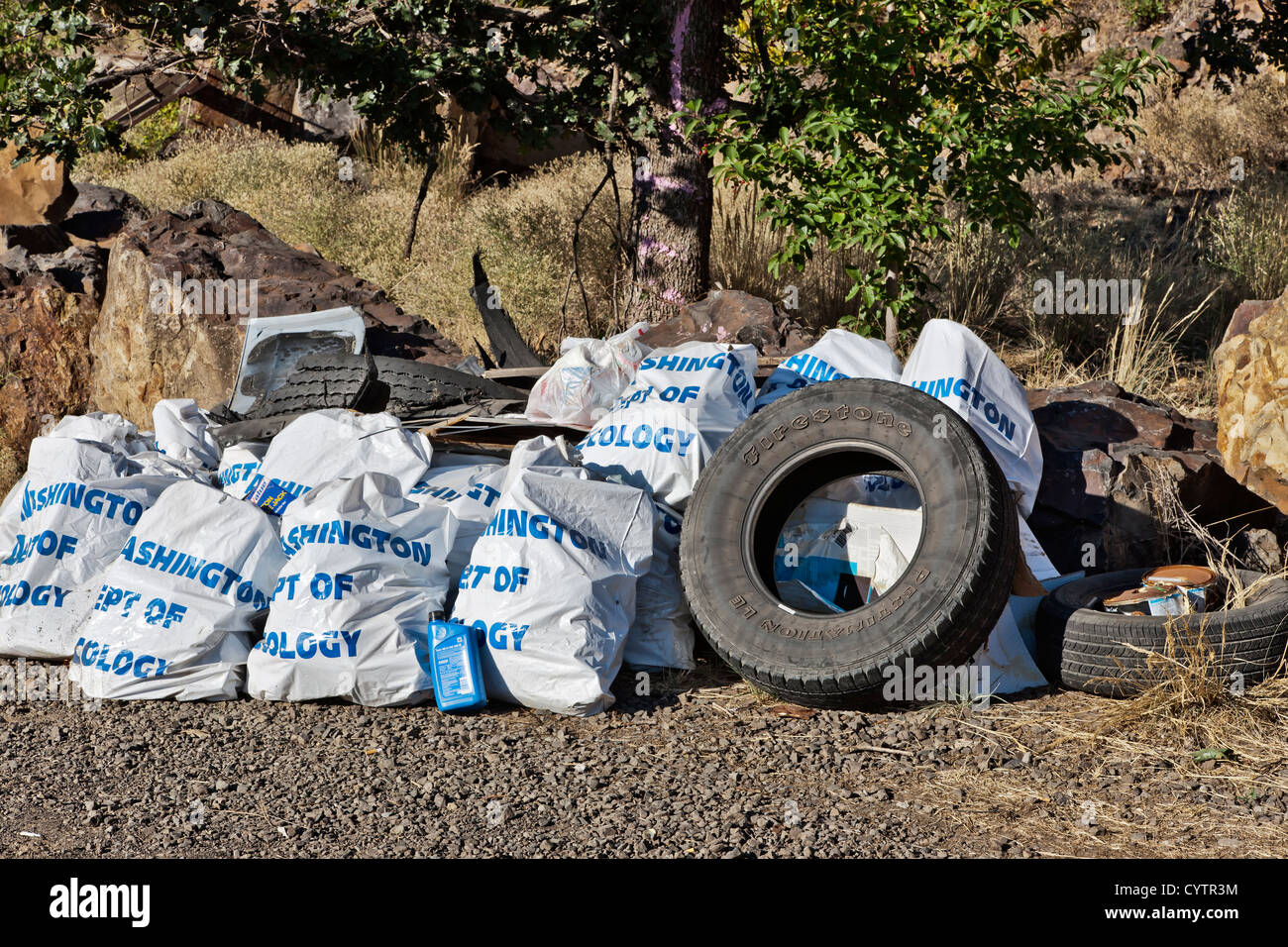 Trash collected along Washington State highway. - Stock Image