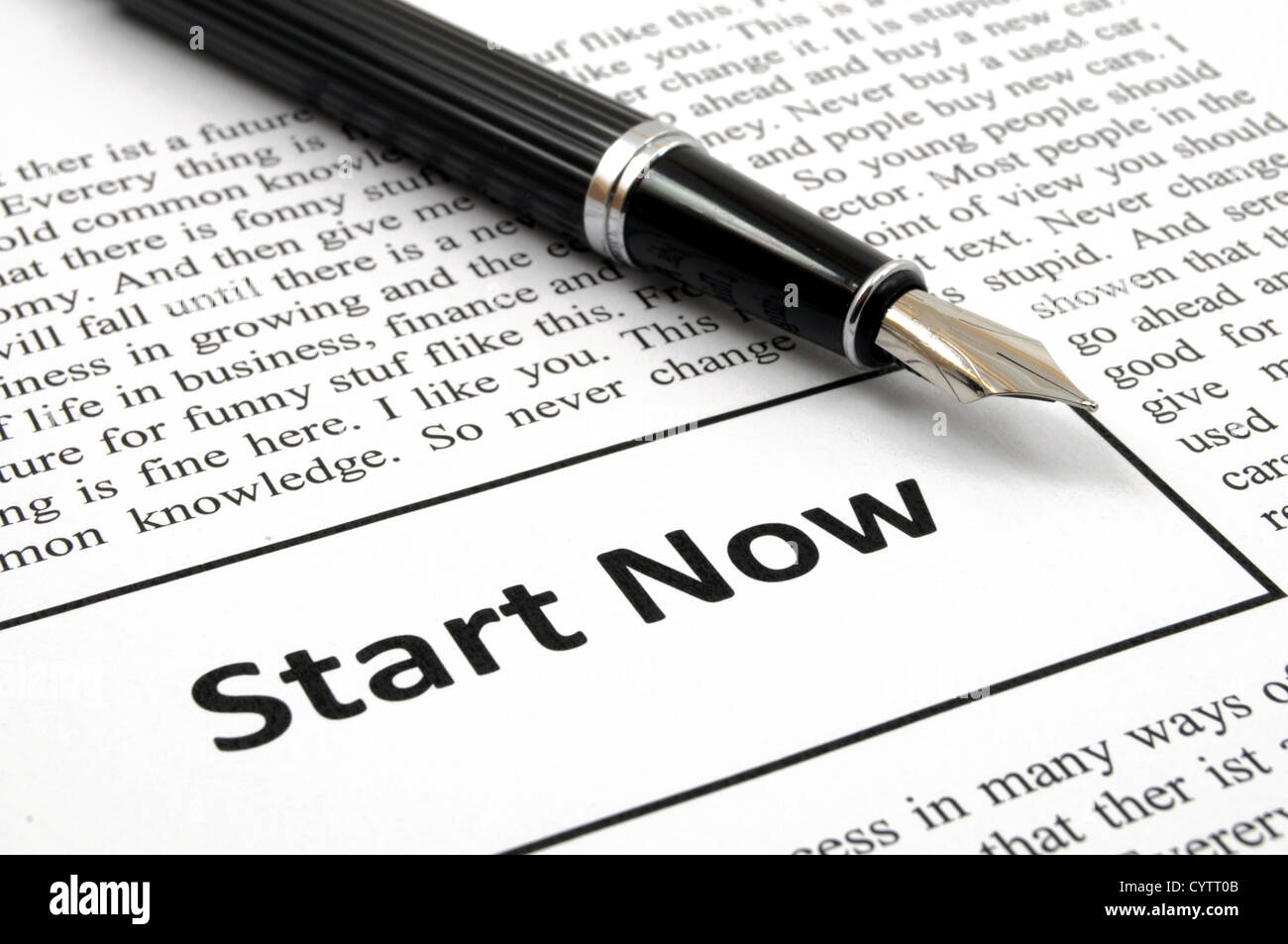 start now concept with newspaper showing business success concept Stock Photo