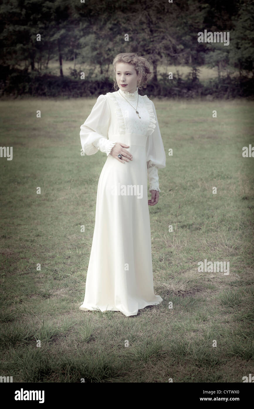 a woman in a victorian dress - Stock Image