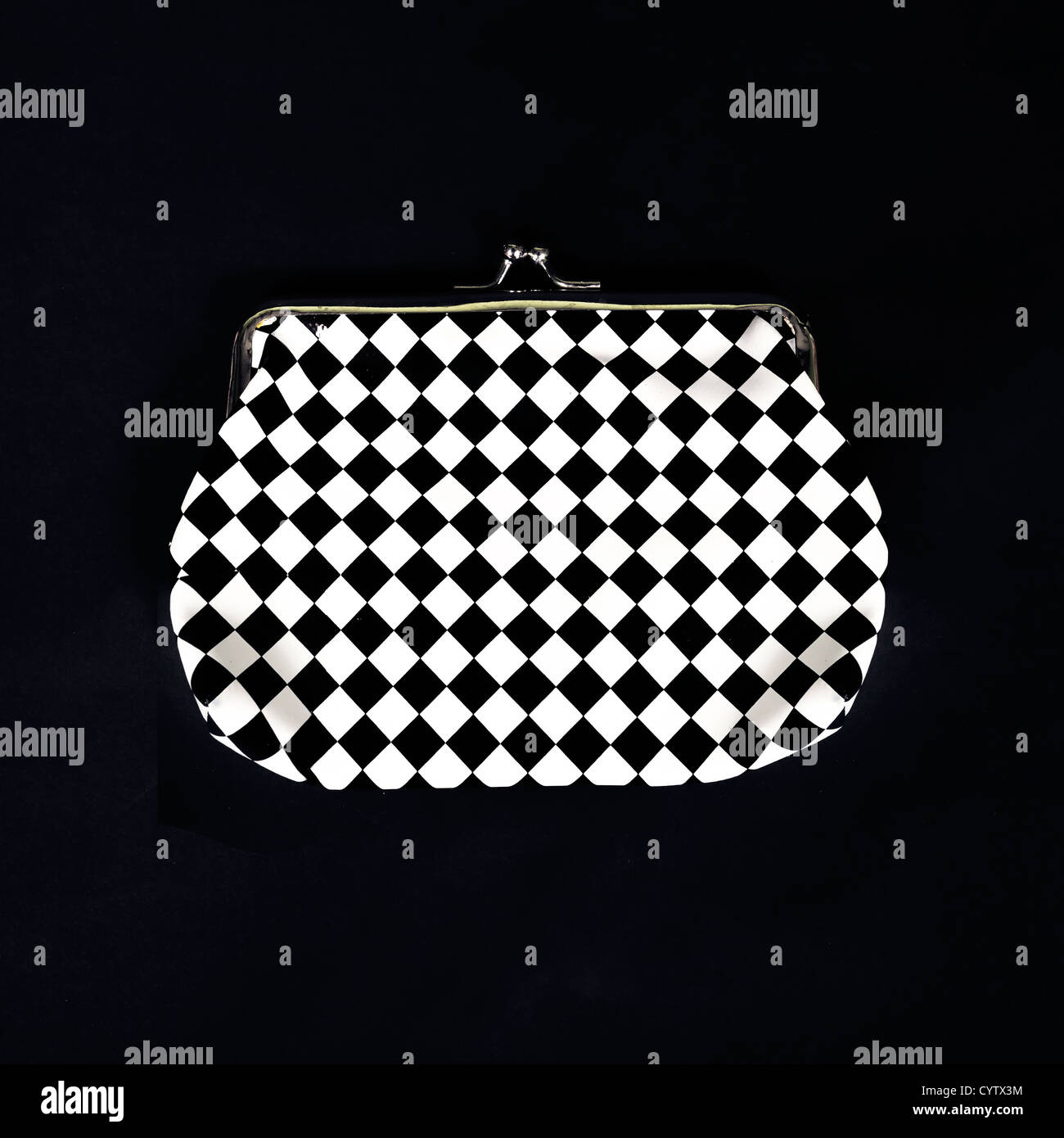 a checkered purse in black and white - Stock Image