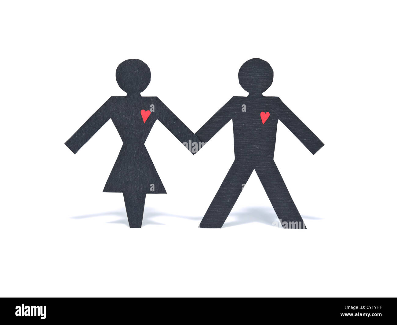 An heterosexual paper figure couple holding hands isolated on white background. - Stock Image