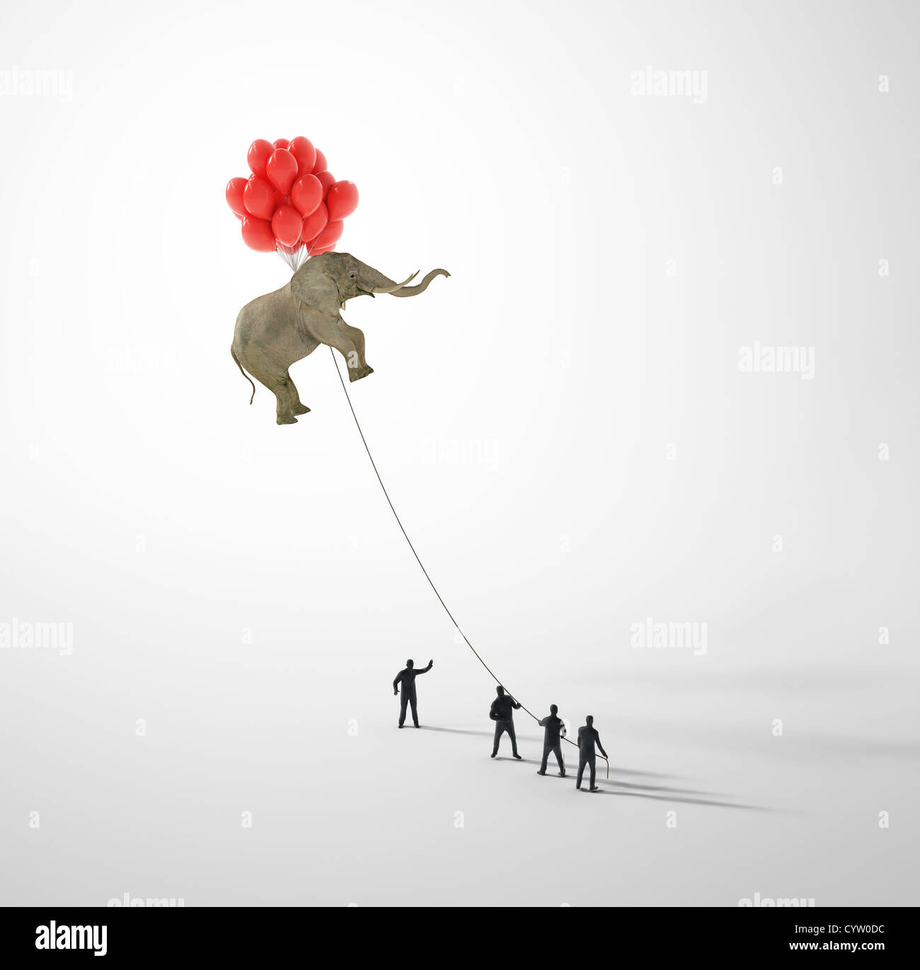 Elephant lifted by balloons and held on a rope by tiny people - Stock Image