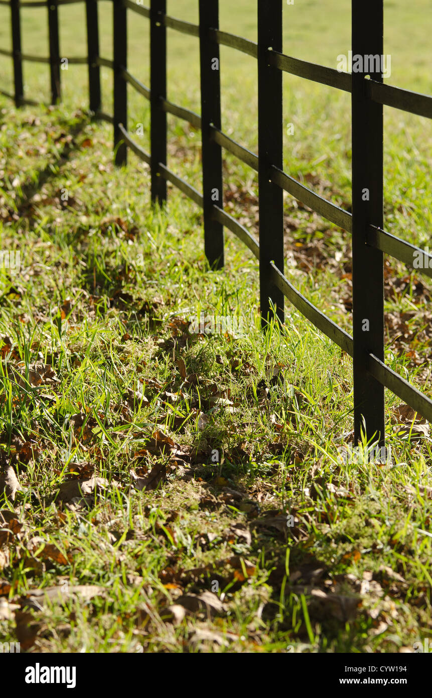 wrought iron steel iron fence painted black as a boundary for estate ...