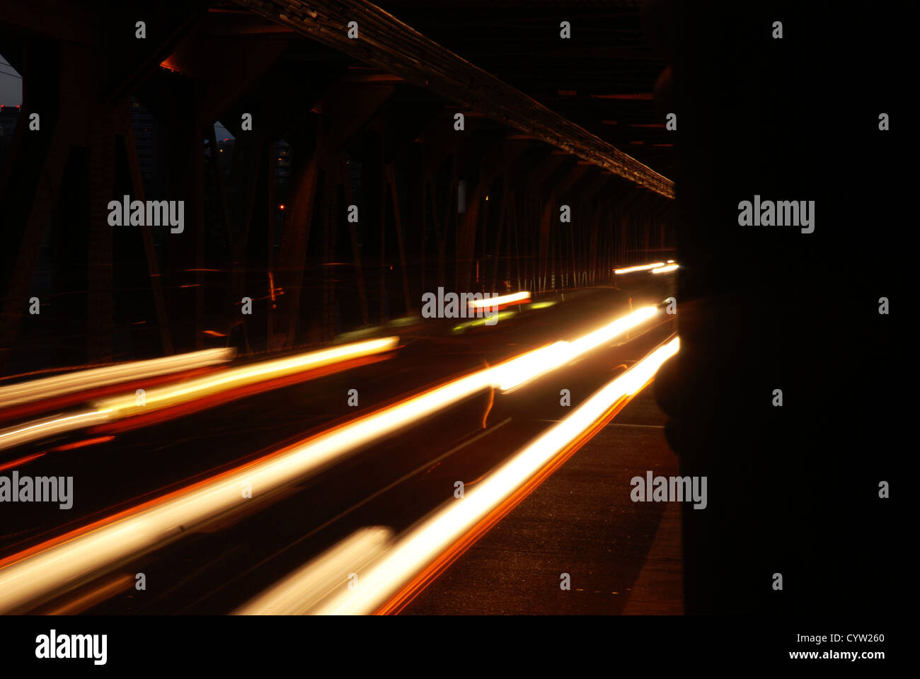 Long exposure of traffic over a bridge at night. - Stock Image