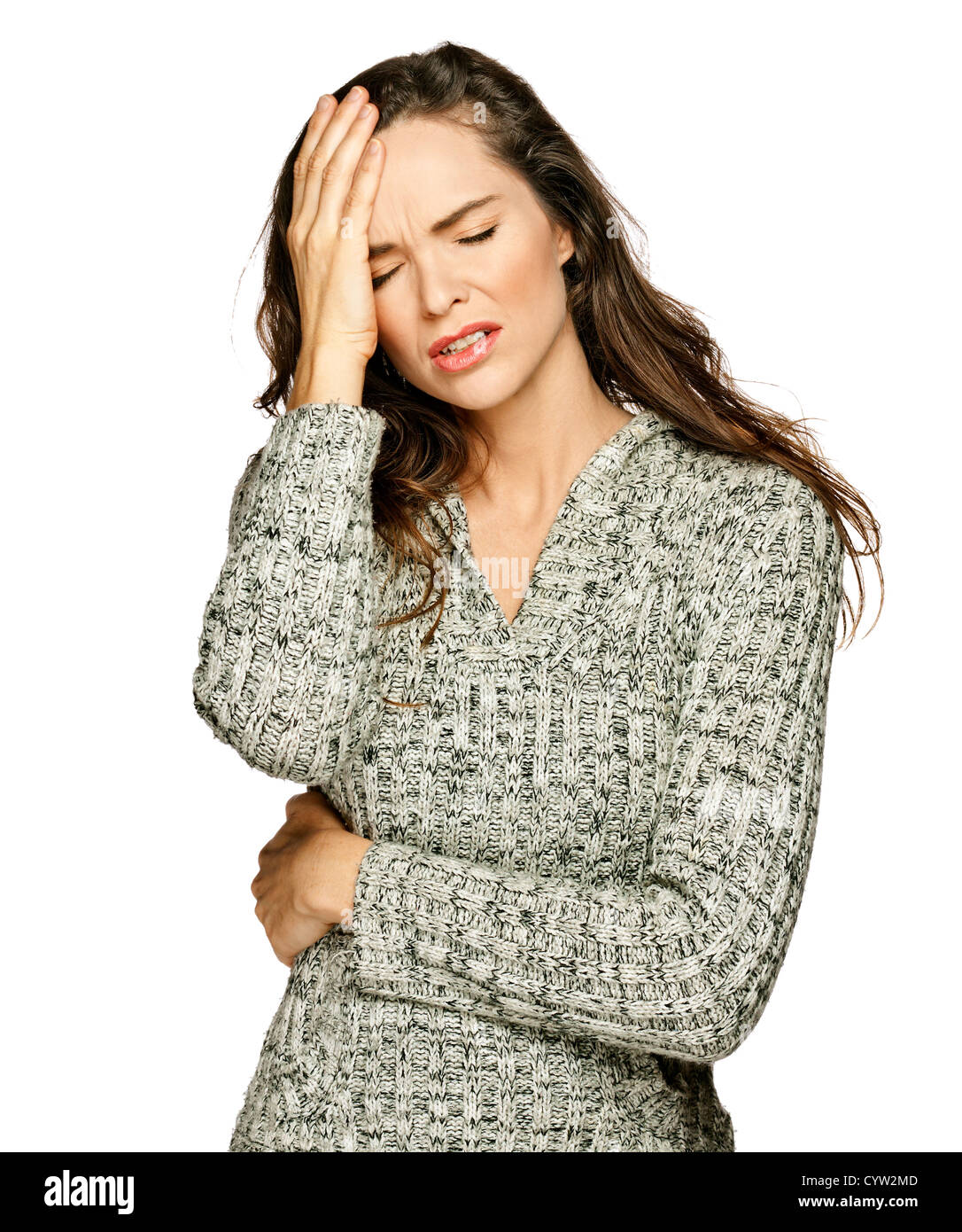 A young attractive woman suffering from illness or headache holding her head. Isolateed on white. - Stock Image