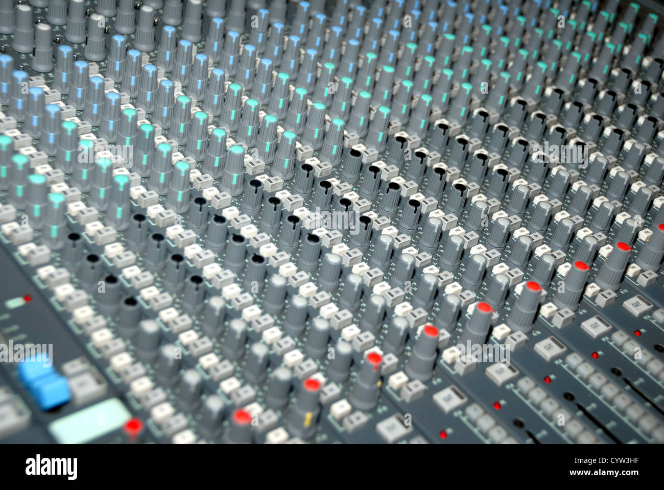 Audio mixing console in a recording studio. Faders and knobs of a sound mixer. - Stock Image