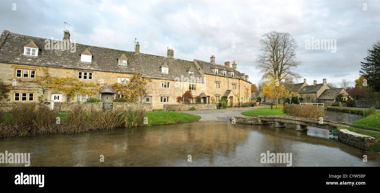 Panorama of the Cotswold village of Lower Slaughter on the River Eye, Gloucestershire, England, UK - Stock Image