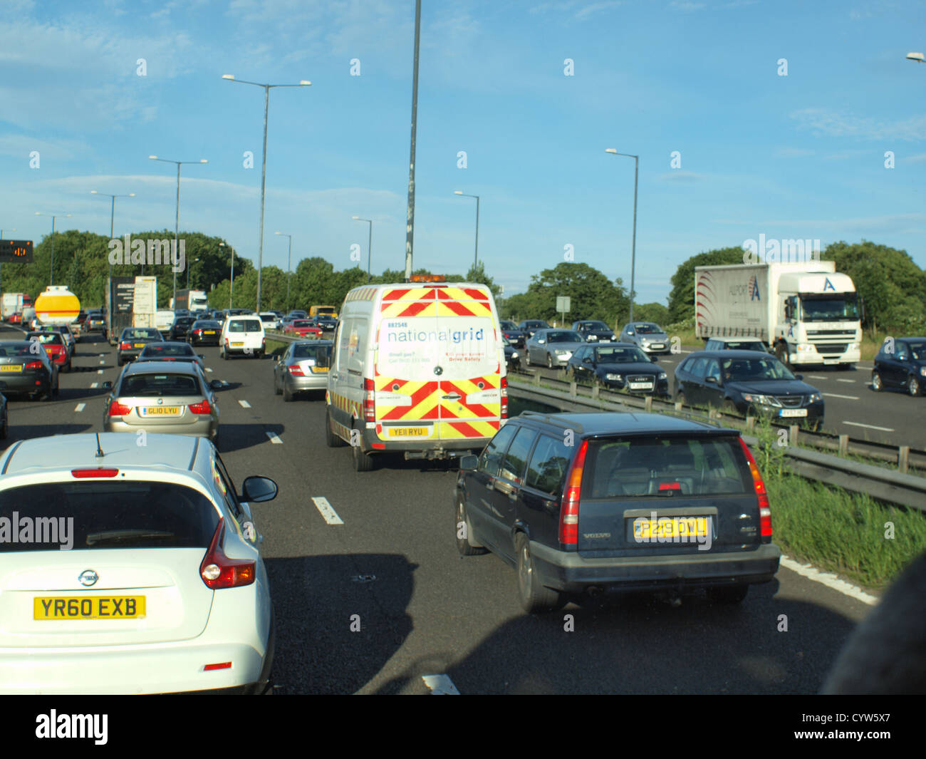 An Assemblage of transport vehicle, trafficking upon a United Kingdom motorway en-route towards their final destination. - Stock Image