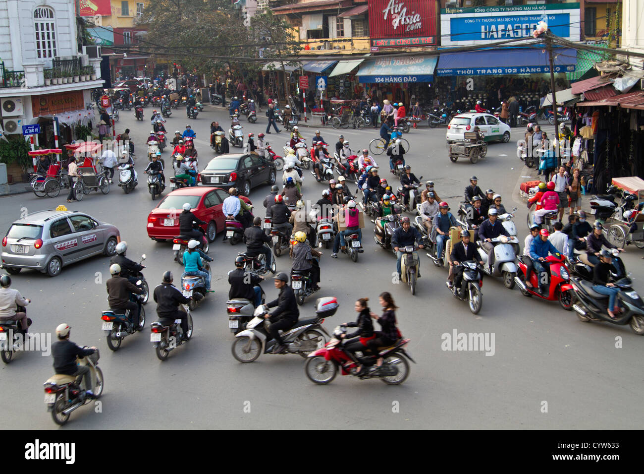 Traffic chaos at a busy intersection in the Old Quarter of Hanoi, Vietnam. - Stock Image