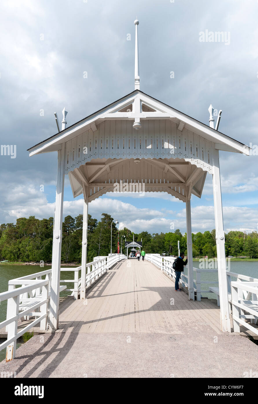 Bridge to Museum Island of Seurasaari, houses and other wooden architecture brought from all over Finland are on Stock Photo