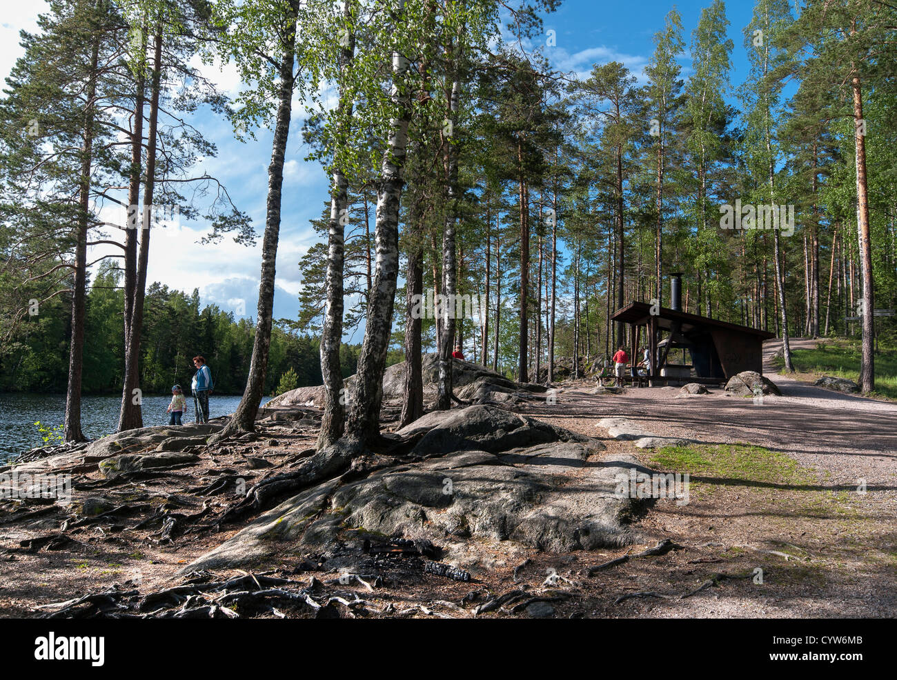 Barbecue area next to lake on the outskirts of Helsinki in Finland - Stock Image