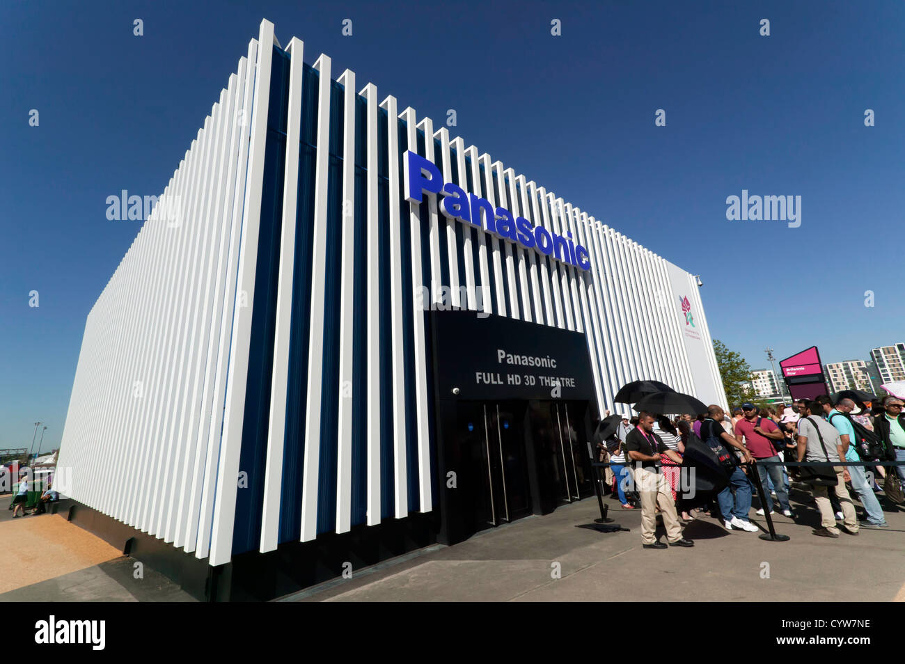 Wide angle view of people queing to enter the Panasonic full HD 3D Theatre, in the Olympic Park, Stratford - Stock Image
