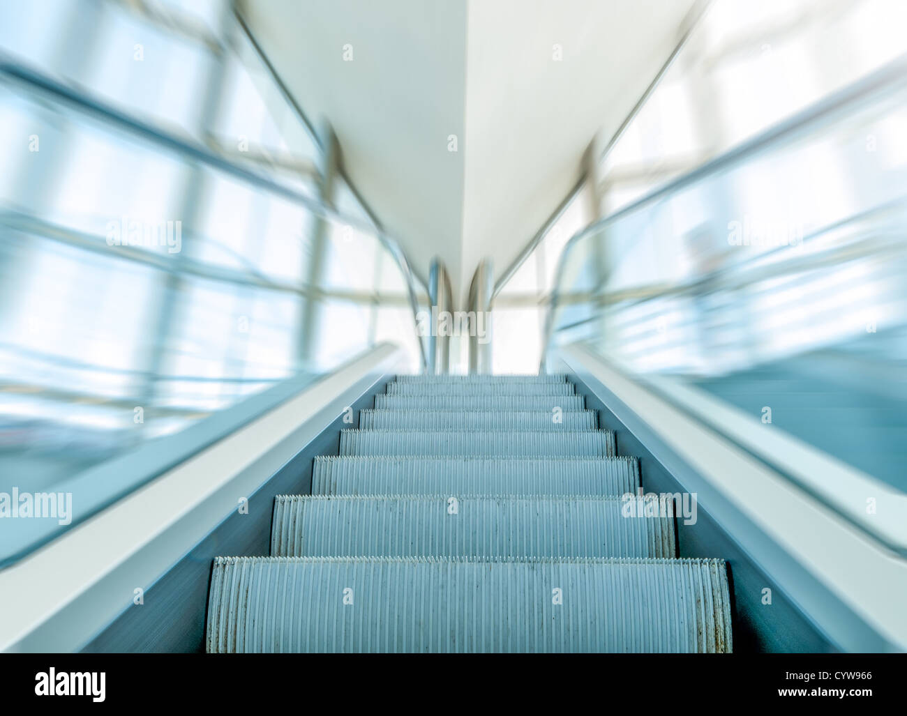 Perfect Close View Of Moving Staircase Or Escalator Inside Modern Business Centre.  Empty Escalator With Blue Glass Handrails In Motion.