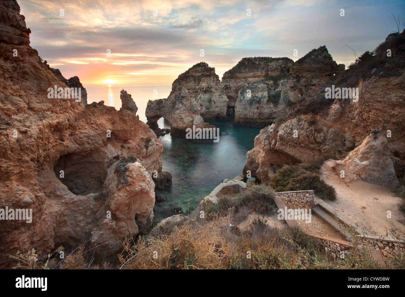 Ponta da Piedade sea stacks and arches captured at sunrise, Portugal. - Stock Image