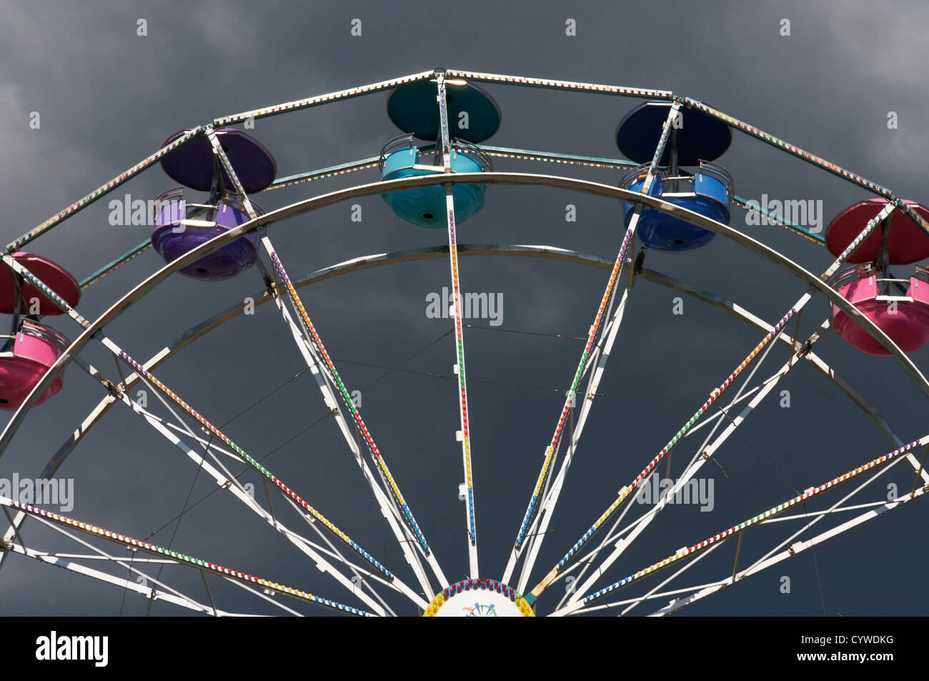 A ferris wheel against a stormy sky Stock Photo