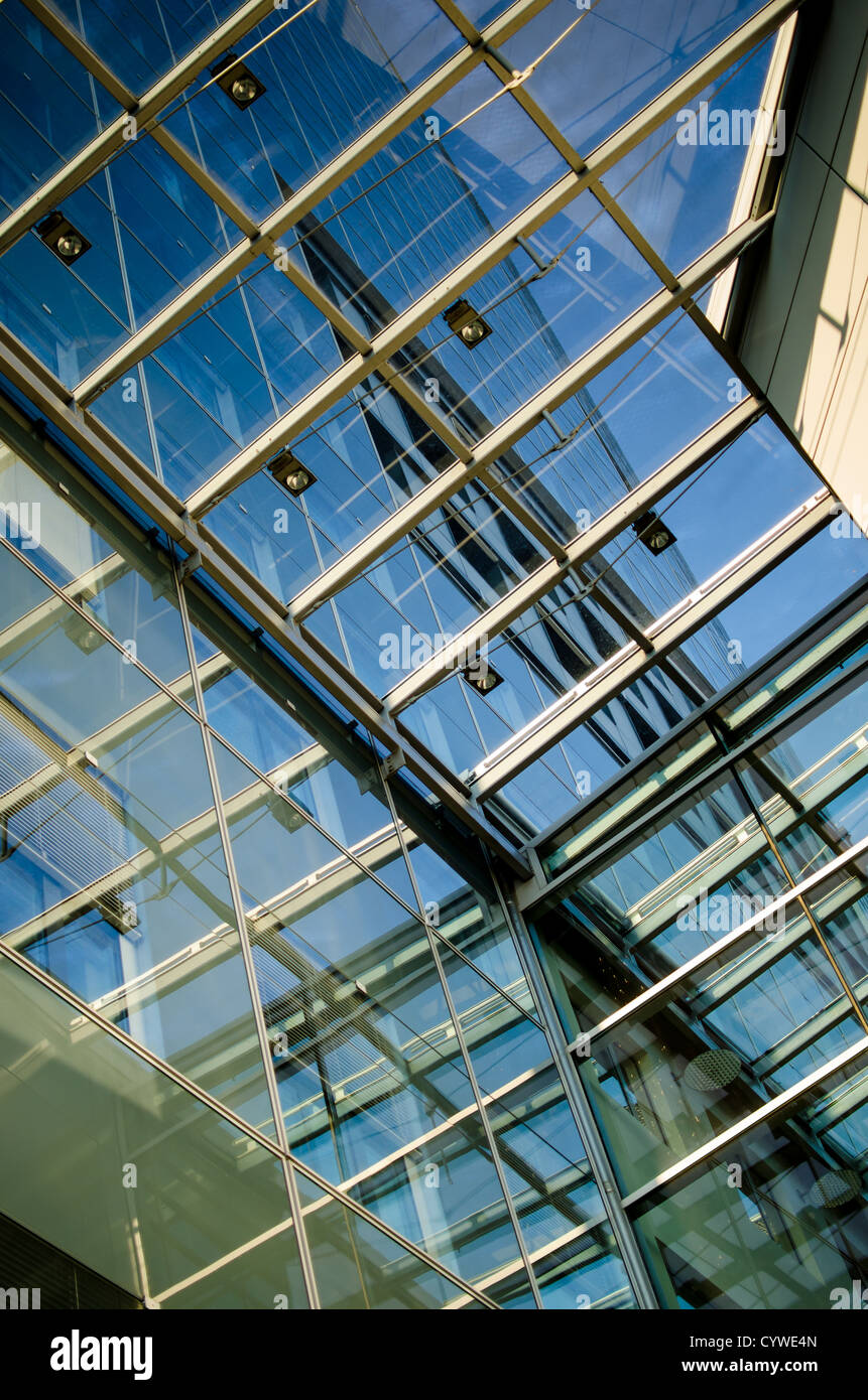 View through a glass-roof of a modern business building - Stock Image